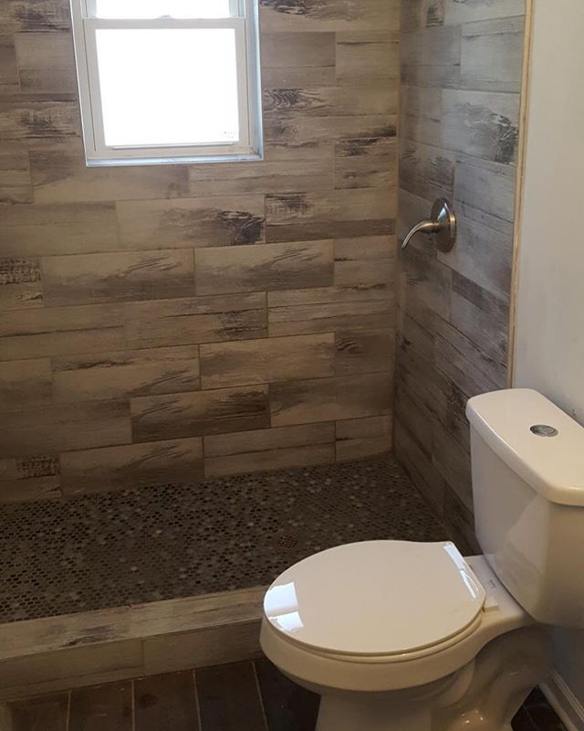 Finishing up fixtures on recent project. We've seen a lot of wood tile in showers lately, what do you think? -⠀⠀⠀⠀⠀⠀⠀⠀⠀ -⠀⠀⠀⠀⠀⠀⠀⠀⠀ -⠀⠀⠀⠀⠀⠀⠀⠀⠀ -⠀⠀⠀⠀⠀⠀⠀⠀⠀ -⠀⠀⠀⠀⠀⠀⠀⠀⠀ -⠀⠀⠀⠀⠀⠀⠀⠀⠀ -⠀⠀⠀⠀⠀⠀⠀⠀⠀ -⠀⠀⠀⠀⠀⠀⠀⠀⠀ #housetour #contemporary #homerenovation #my100yearoldhome #remodel #restoration #Chicagoplumbers #chicagobusinesses #plumbing #newconstruction #modernhome #homedesign #interiordesign #interior123 #happyhome #homelife #luxuryliving #luxury #architecture #modernhouse #smallspacesquad #chicago #chicagobusiness #windycityrehab #realestate #realtorsofchicago #chicagorealestate #fixerupper #hgtv #tilestyle