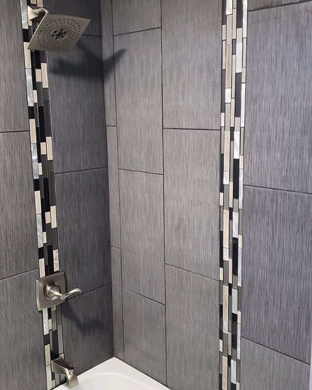 Tile style goals! How'd you like to come home to this sleek modern shower?  ___ #chicagoluxury #chicagocontractor #homeimprovement #fixerupper #windycityrehab #fliporflop #chicagorealtor #chicagobusiness #luxuryhome #guestbathroom #bathroomrenovation #tilestyle #greytile #modernhome