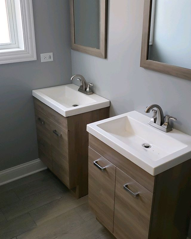 A bathroom built for two. What are your thoughts on wood inspired tile and features?  ___ #woodtile #guestbathroom #bathroomrenovation #modernhome #chicagorealtor #chicagorealestate #chicagocontractors #chicagobusiness #modernluxury #csliving #fixerupper #windycityrehab #hgtv #homeimprovement #fliporflop #homedecor