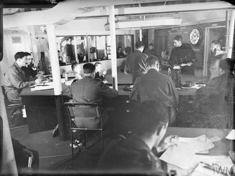 Scene in the operations room of HMS HILARY off Sicily at dawn of the first day of the invasion of the island. 9-10 Ju.jpg