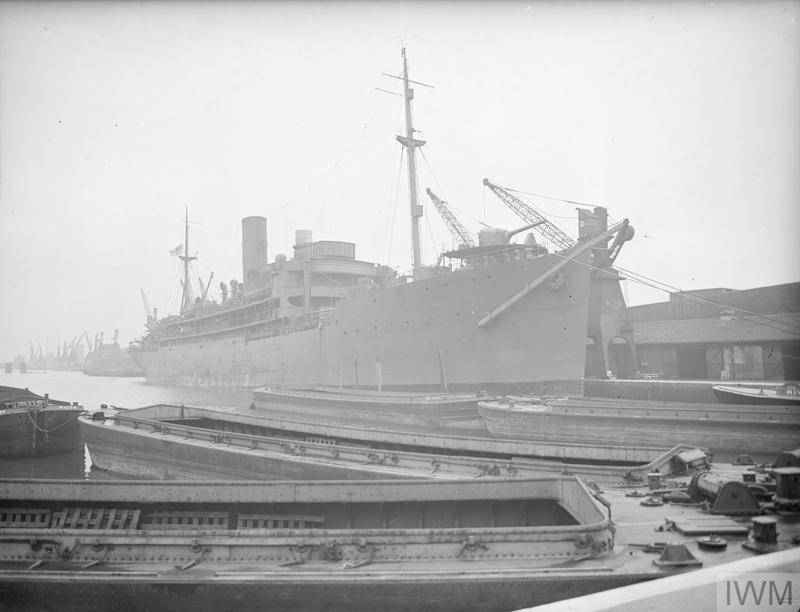 HMS HILARY lying in the basin 31 MARCH 1942, SURREY DOCKS, LONDON..jpg