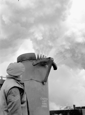 A smoke generator laying a smokescreen to hide the movements of the 3rd Canadian Infantry Division during Operation VERITABLE, Wyler, Germany, 15 February 1945.