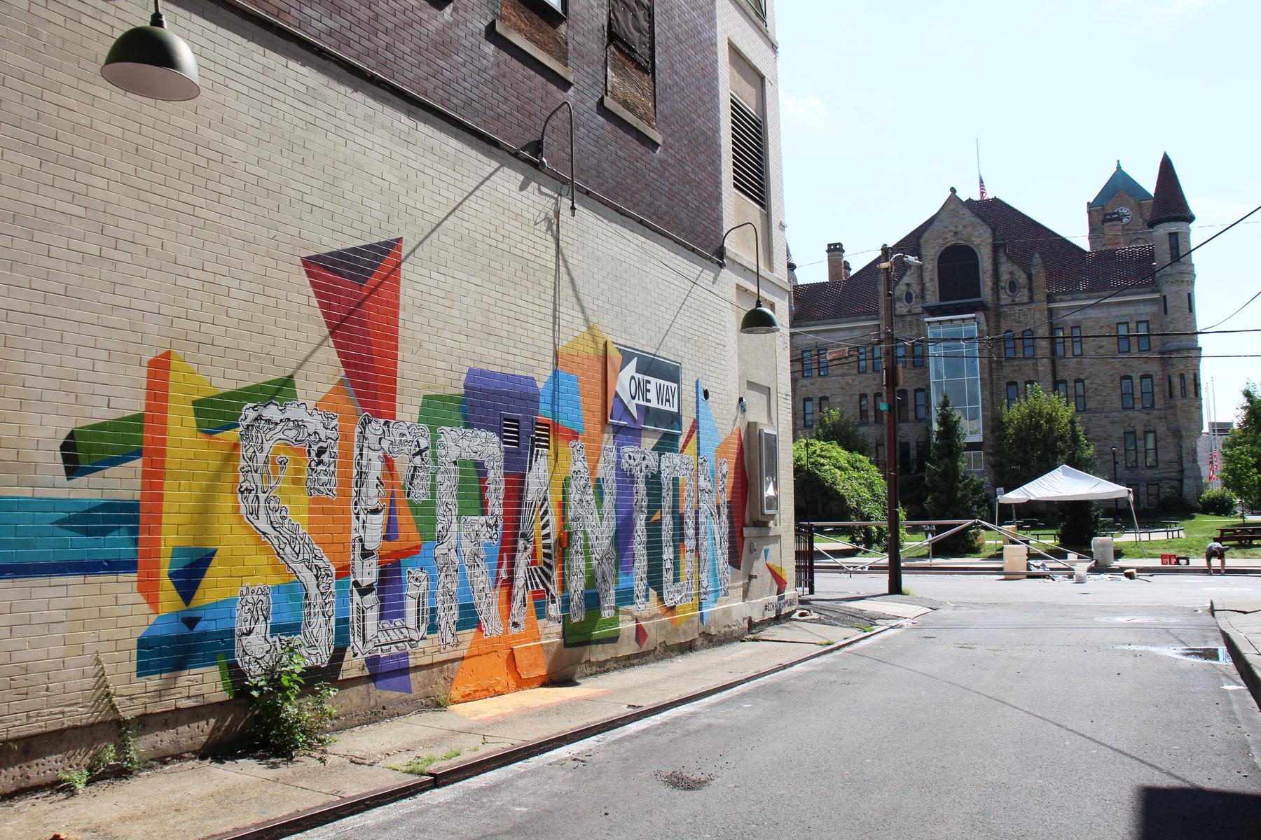 srcanton-mural-artist-eric-bussart-left-.jpg