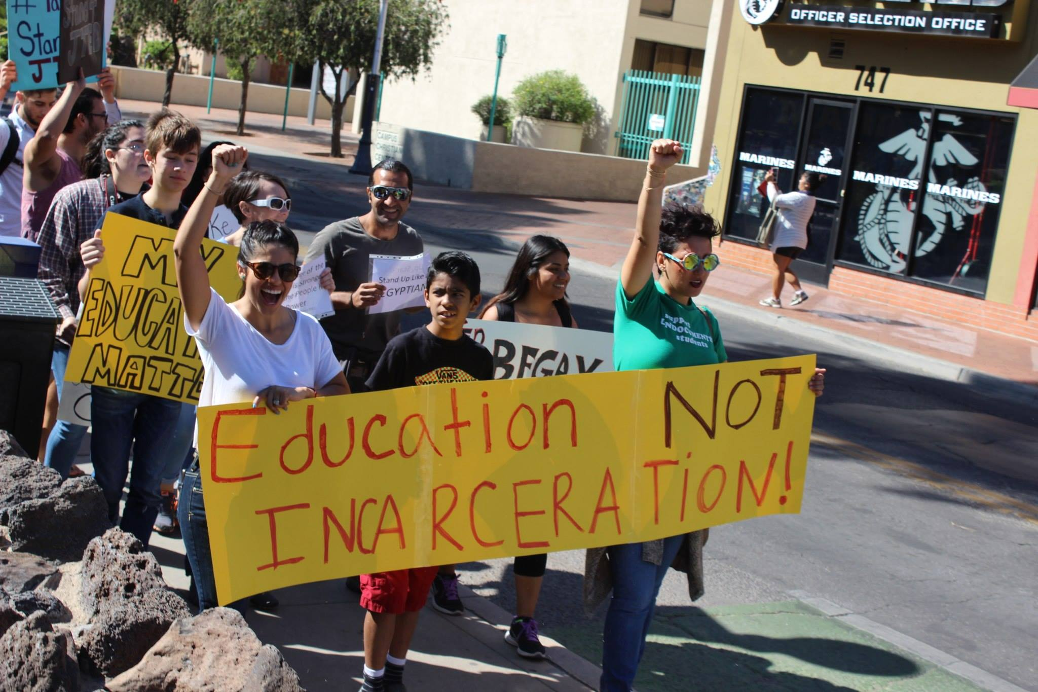Marching through the University of Arizona's Book Festival to raise awareness around lack of quality education, 2014.