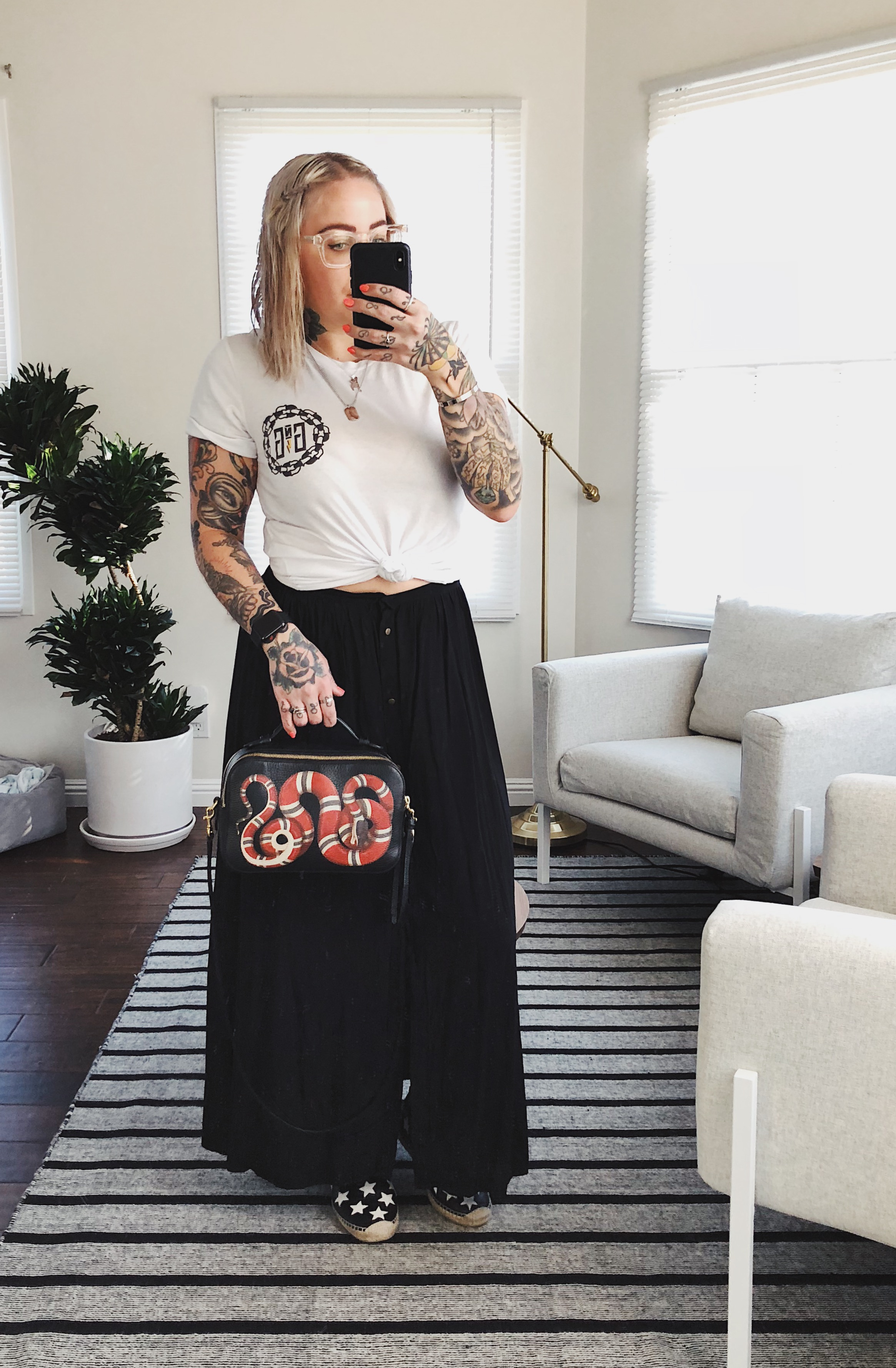À la mode - I am not one to spend hours getting ready, and I am not one to dress uncomfortably! It's all about keeping it simple, feeling good about yourself and be comfortable.I paired an a-line buttoned skirt with a tattoo shop t-shirt (or any favorite band tee you may have!). For a very casual look, I picked Saint-Laurent espadrilles, but a pair of Converse would do just as good! As I do almost every day, I grabbed my snake Gucci purse because lets be honest, it is the best! Unfortunately, it has been sold out for a very long time, so I will try my best to link up similar bags at a more affordable price every time it's part of an outfit.Click here to shop skirt.Click here to shop shirt.Click here to shop similar sneakers.Click here to shop similar bag.