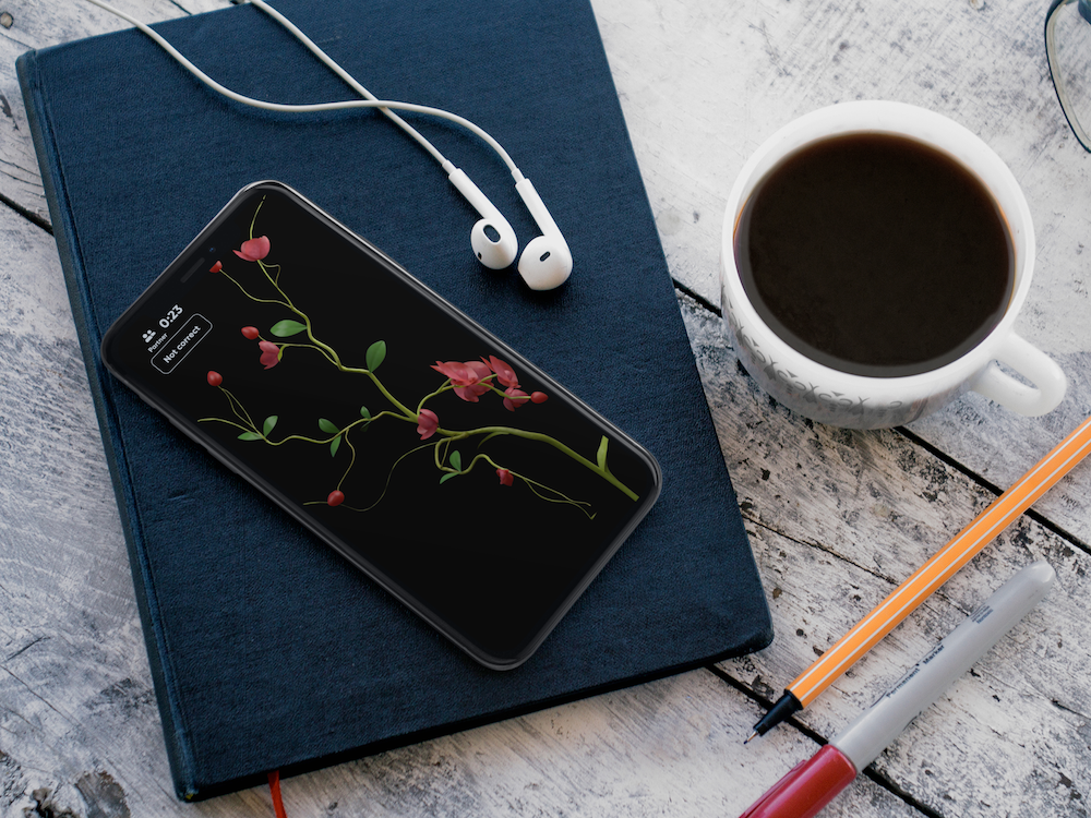 iphone-x-mockup-lying-on-top-of-a-book-while-near-a-coffee-cup-and-headphones-a17220-2 copy.png