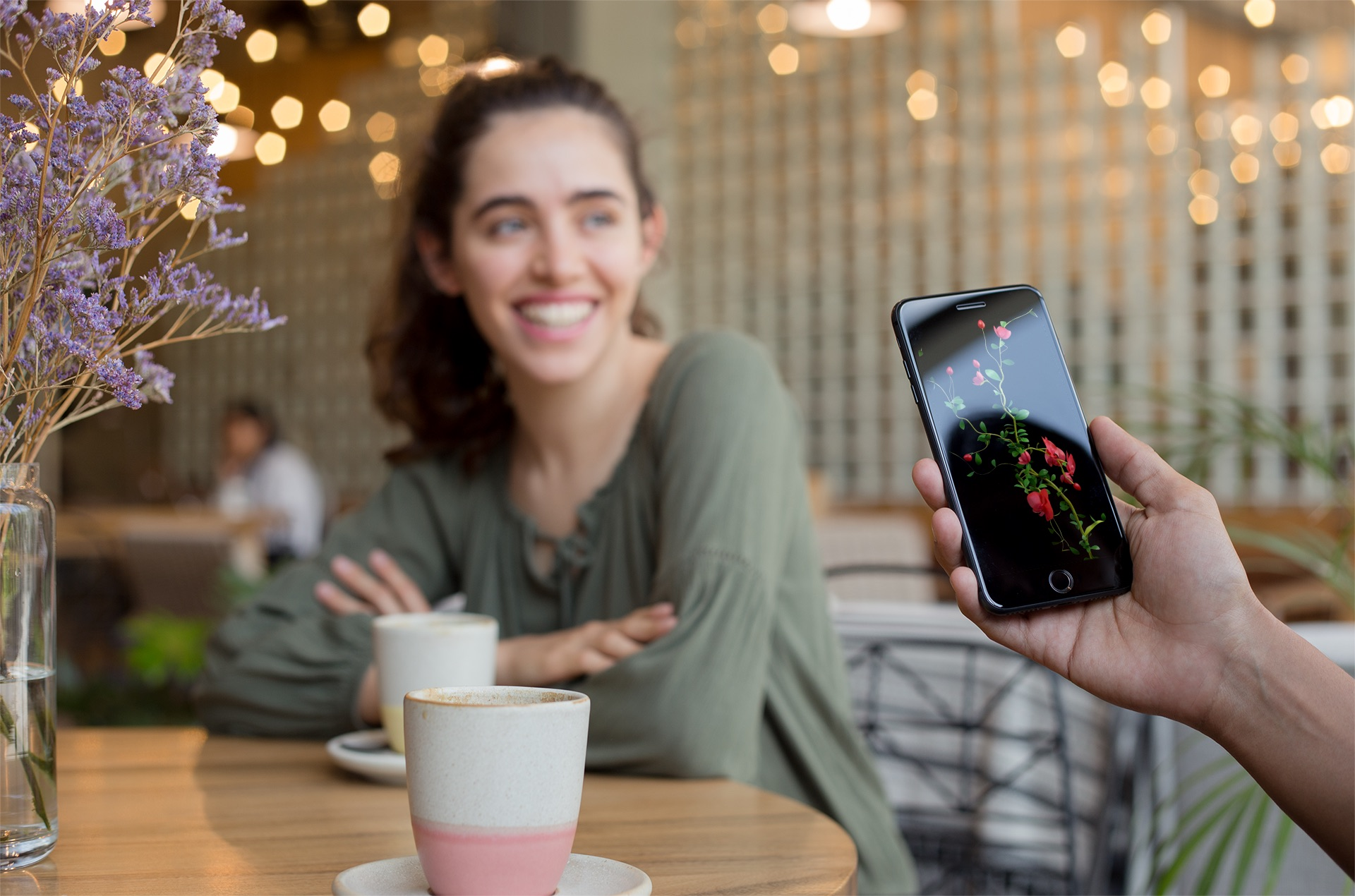 space-gray-iphone-8-plus-mockup-featuring-a-man-with-a-girl-at-a-coffee-shop-a21265+copy.jpg
