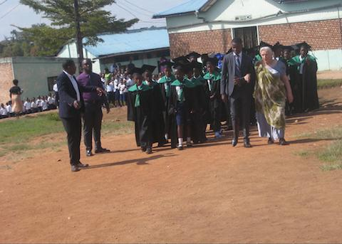 After seating the Kindergarten class the parade proceeds, with P6, Sewing Center & undergraduates arriving at the field.