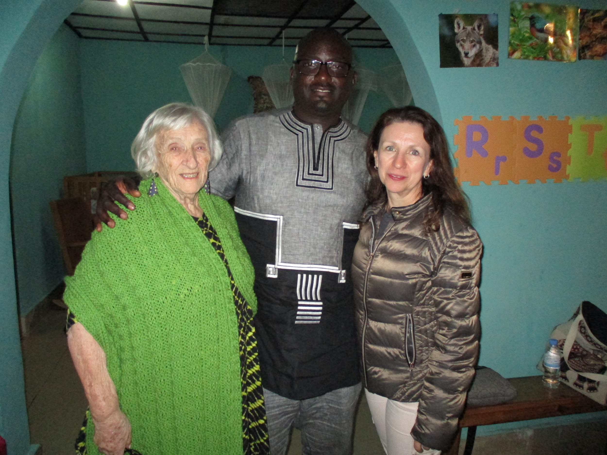 Modeling the new shawl. Mama posing with Urukundo executive director Jean Marie Ntwari and Gabrielle after devotions.