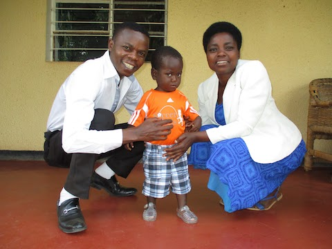 Pastor Yves and Chantel give a gift of clothes to a precious little boy.