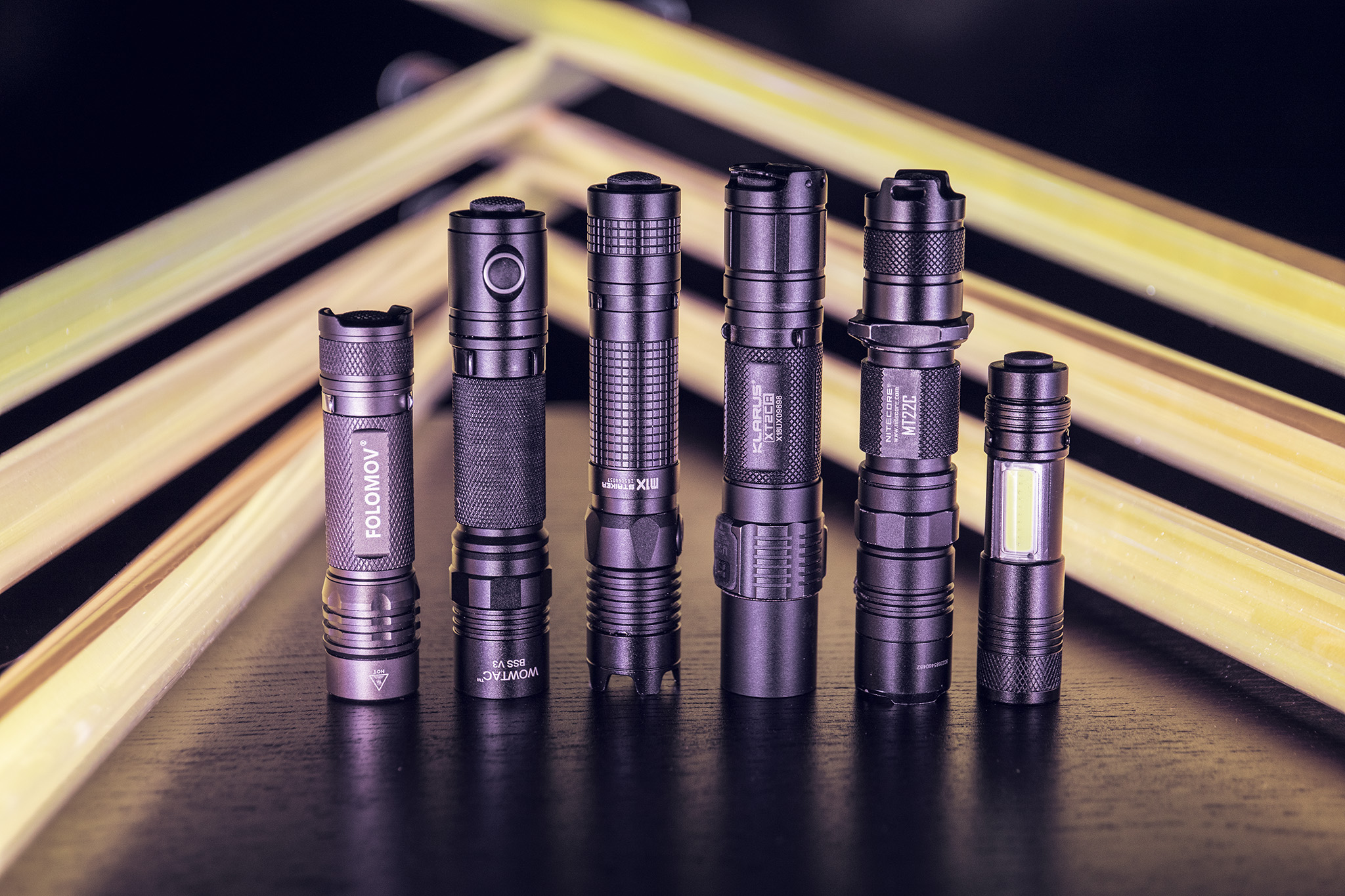 From left to right: Folomov 18650s, Wowtac BSS v3, Olight M1x striker, Klarus XT2CR, Nitecore MT22c, Outline flashlight