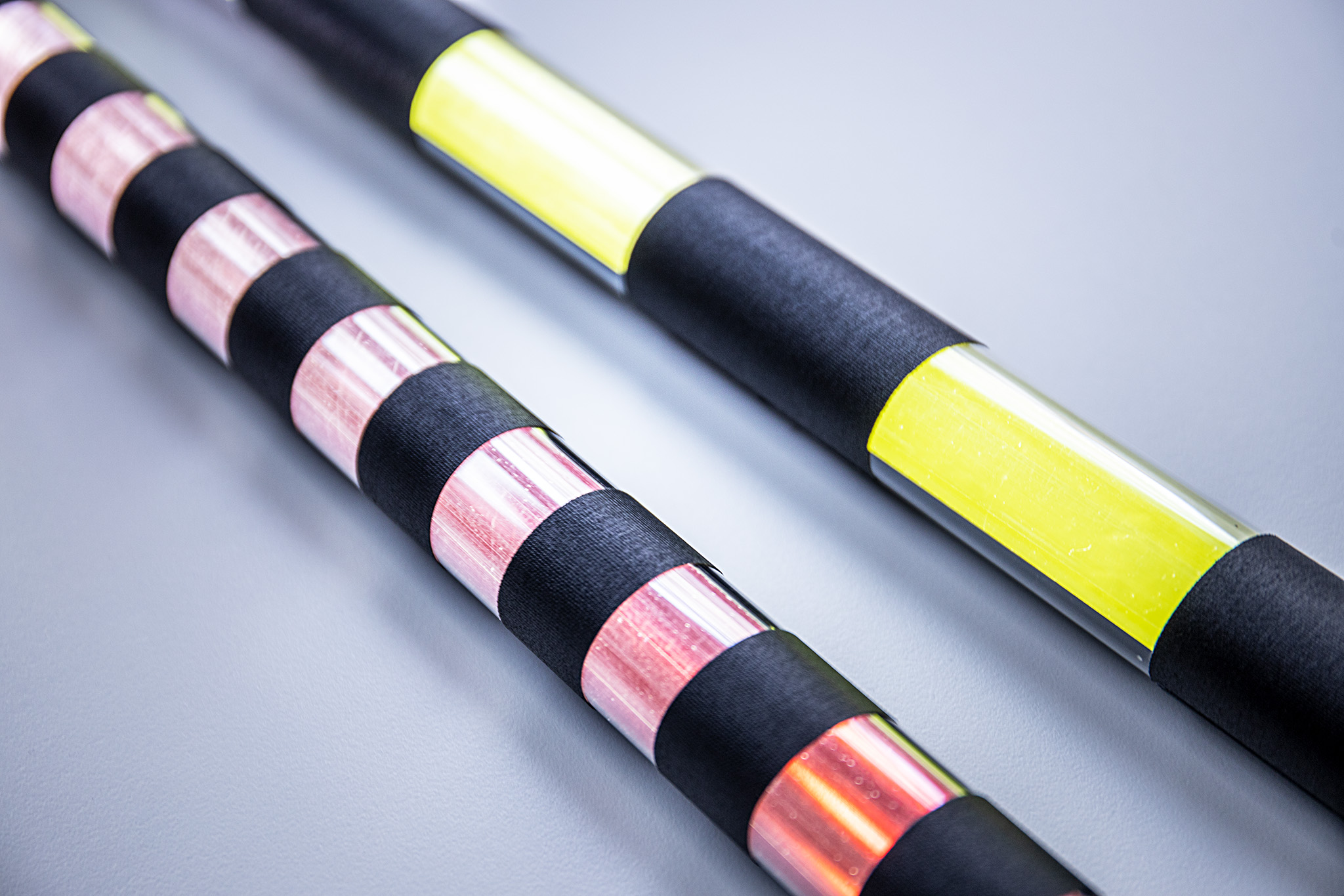 """1"""" stripes cover on a red tube and 3"""" stripes cover on a yellow tube"""