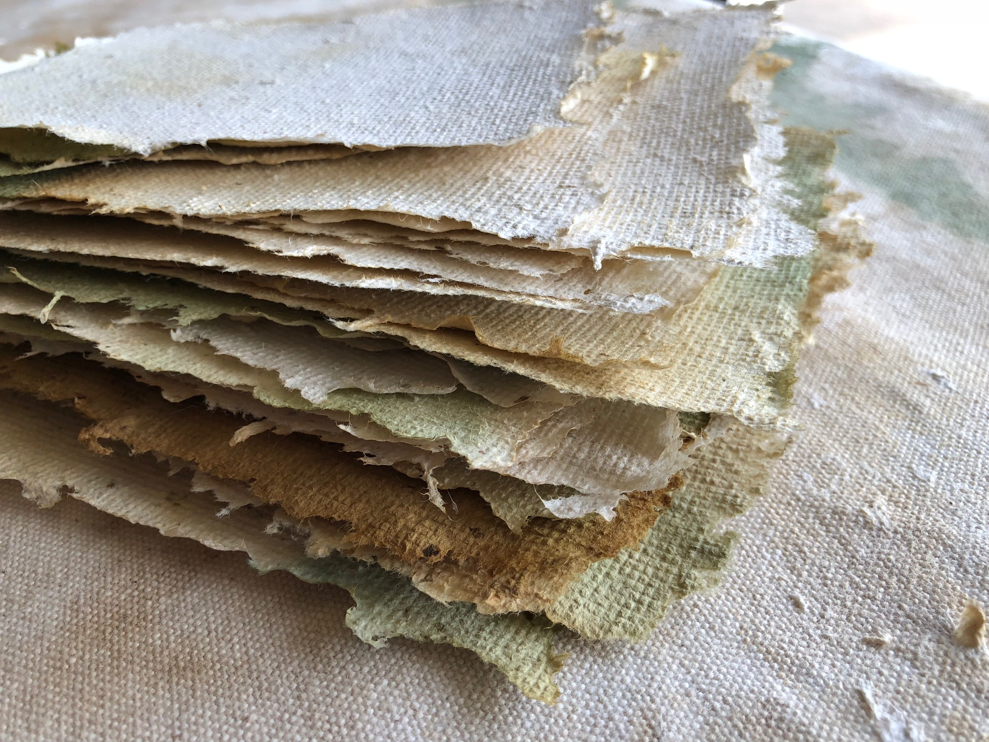 Stack of handmade paper. approximately 6 x 4 inches each. Photo courtesy of the artist.