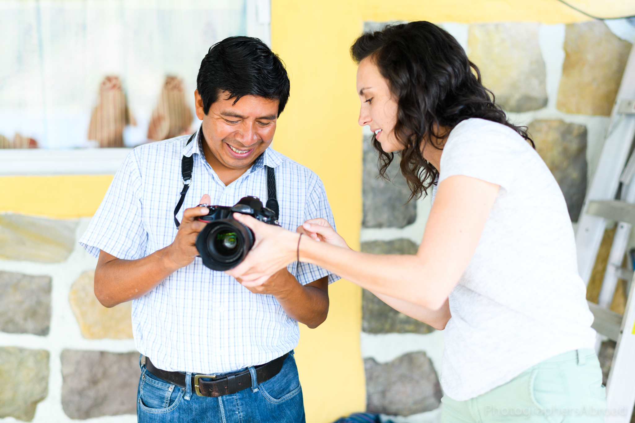 School director René is interested in photography - here, Molly shows him some settings on our cameras.