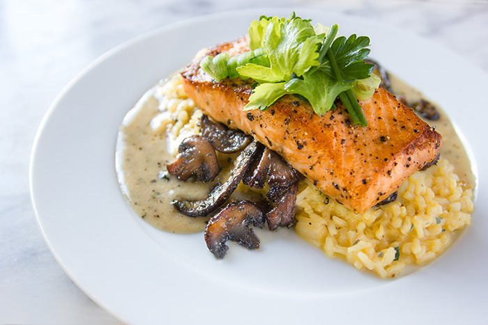 Salmon cooked with NC Red Spice over a buttery bed or risotto with smoked mushrooms and a wine sauce.