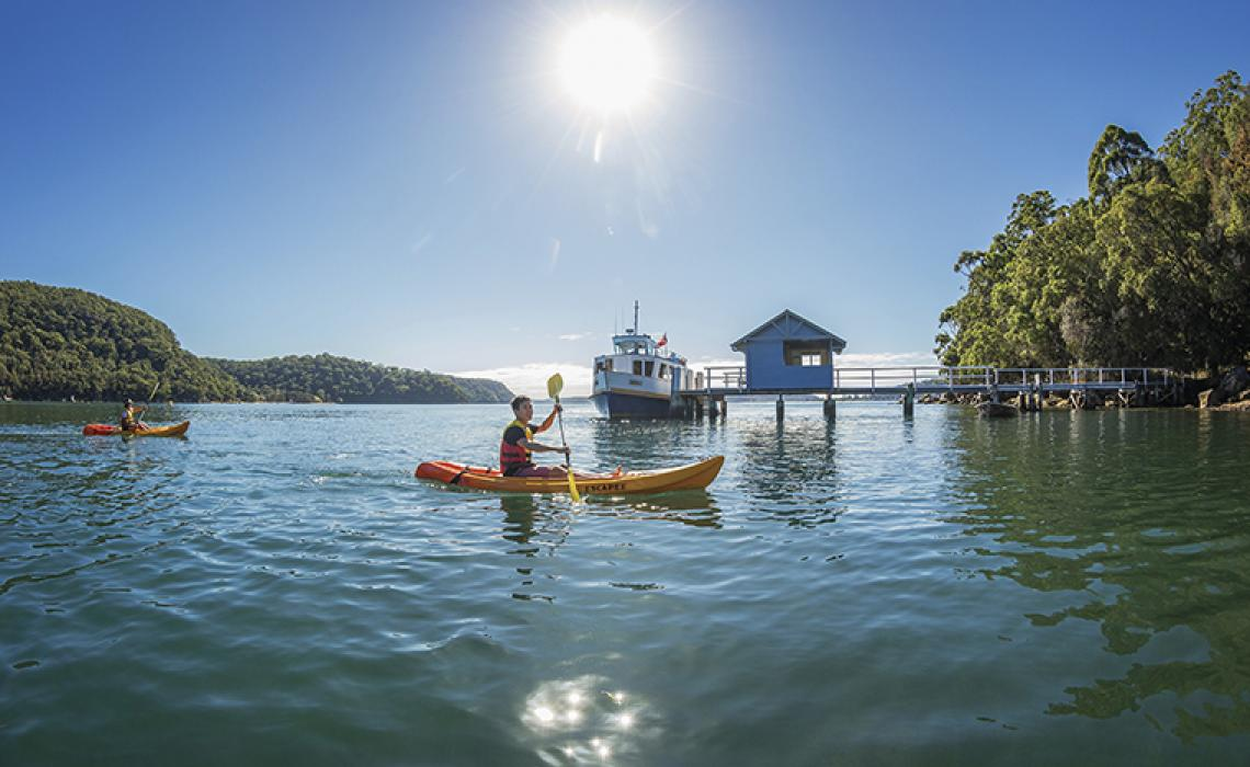 Friends_kayaking_on_Pittwater_Bennets_Wharf_Coasters_Retreat.jpg