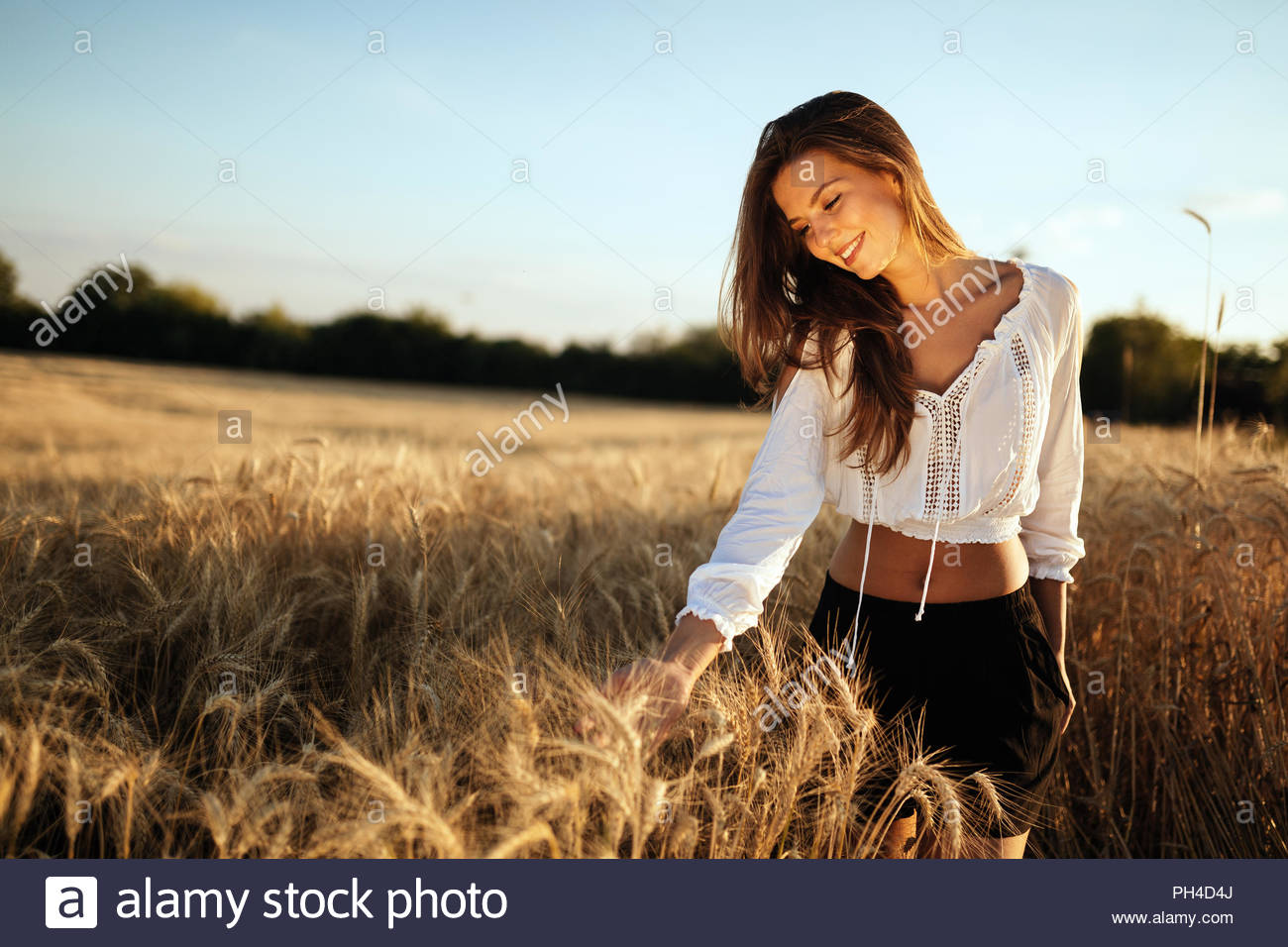 young-beautiful-woman-spending-time-in-nature-PH4D4J.jpg