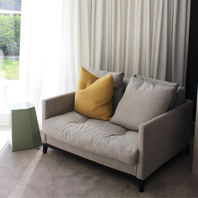 Another before and after of a lounge we re-designed to suit our lovely clients' taste. They felt their house didn't really reflect them. For this lounge we took it from dark & moody to bright & light with a beachy feel. Changing the colour of the fireplace surround was a must. We love this concrete look 🙌🏻. White beautiful sheers taking the place of the navy window treatments also totally changed the look of this room while giving it a luxurious feel.  I totally love this little sunny cozy corner spot!! Other side of lounge to come! . . . #venturearchitectural #nzarchitecture #interiors #design #interiordesign #nzdesign #instadecor #interiorstyling #interiorinspo #homedecor #homestyle #decor #loungedecor #livingroom #livingroomdecor