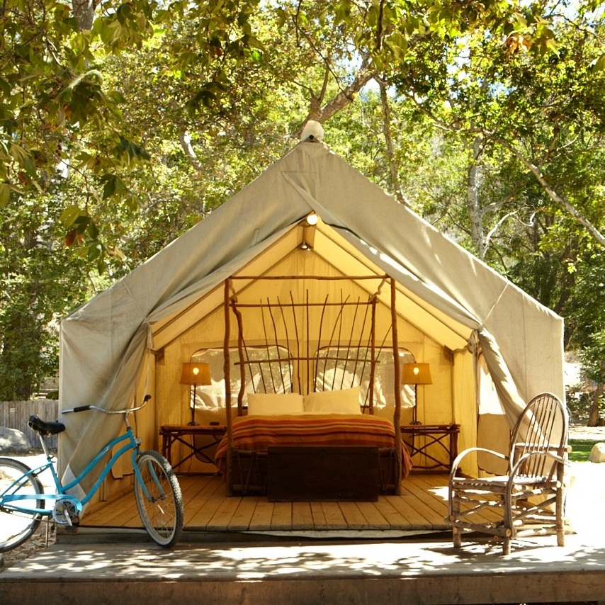 PRIVATE TENT | QUEEN BED W/ SHARED BATH  Features: Shared Bath, Nature Views, Screen windows, Bedside tables, chairs, a small desk, Small heater and electric lamps, outdoor picnic table & firepit