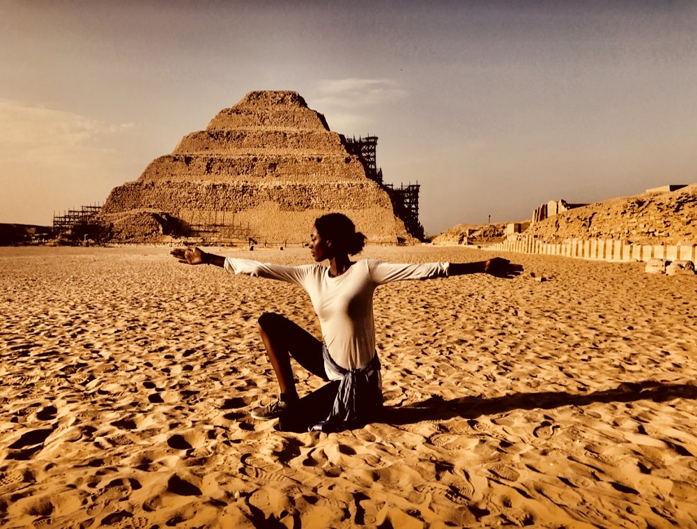 Return to Kemet Co-founder, Sarah Wes practices the pose of MAAT at Saqqara in Egypt
