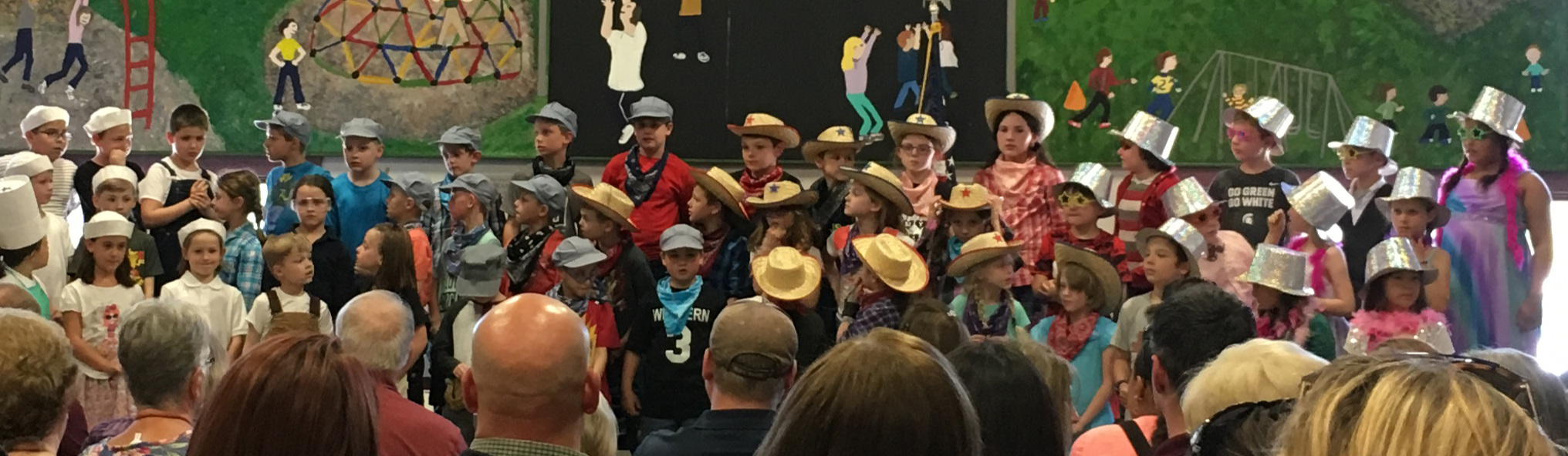 Monkey Boy's spring performance. He's one of the movie stars in the glittery silver hat on the top row.