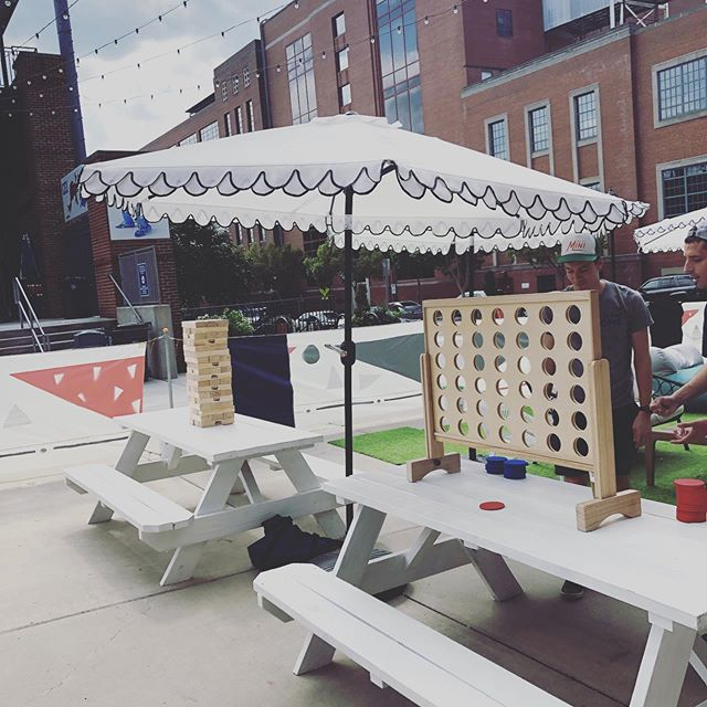 MINI ⛳️GOLF. GIANT JENGA. New patio games installed just in time for fall. Old school giant connect four and jenga brought even @dukeathletics and @uncchapelhill fans together this afternoon and there's a giant beer pong set in the back awaiting worthy opponents... . . #connectfour #jenga #giantjenga #patioweather #lawngames #drinklocal #draftbeer #nccraftbeer #lawngames #giantconnectfour #drinkinggames #minigolf #wine #frosé #mimosa #saturday #sundayfunday #weekendvibes
