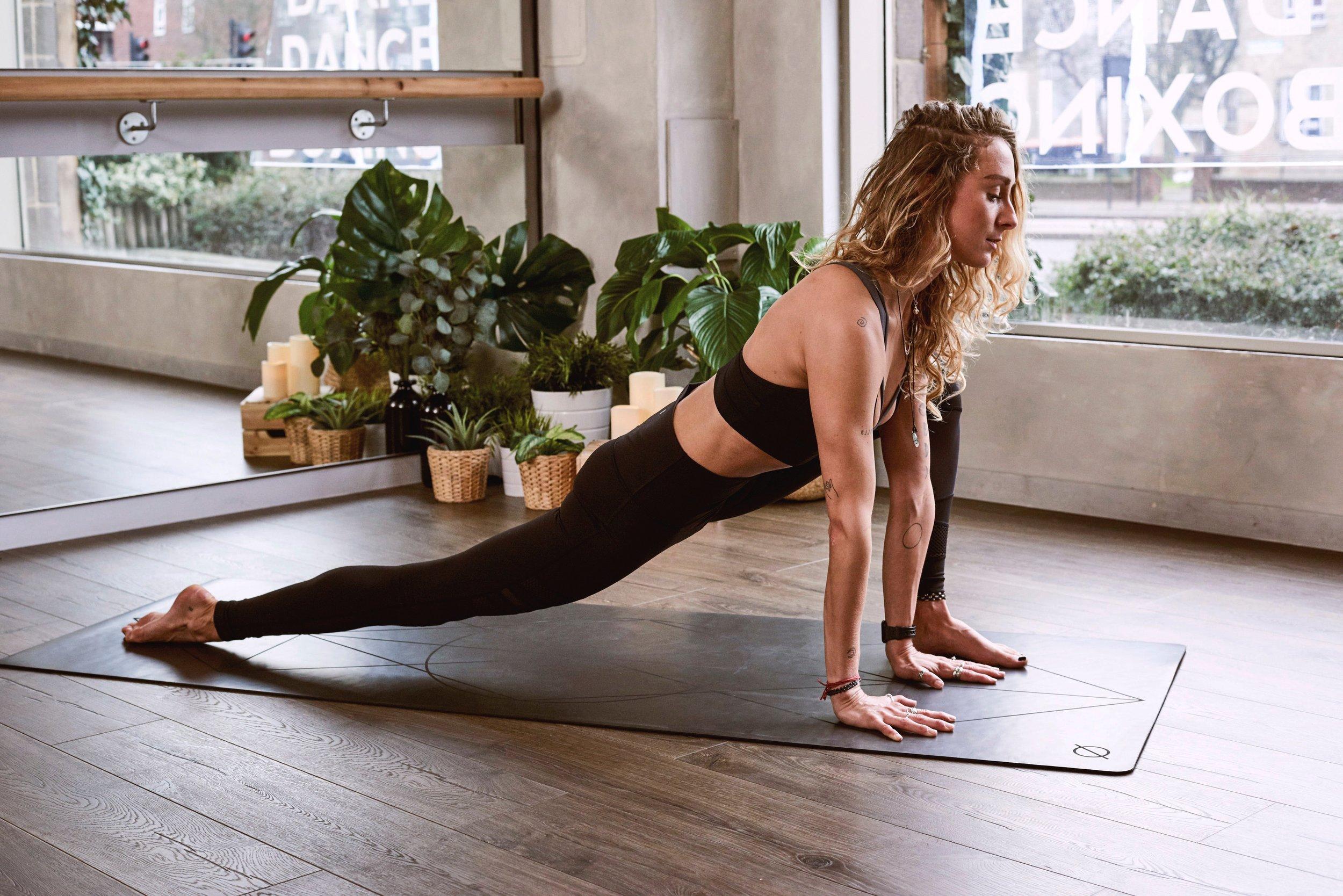 girl doing hot pilates at SWEAT Yoga Studio in Albuquerque