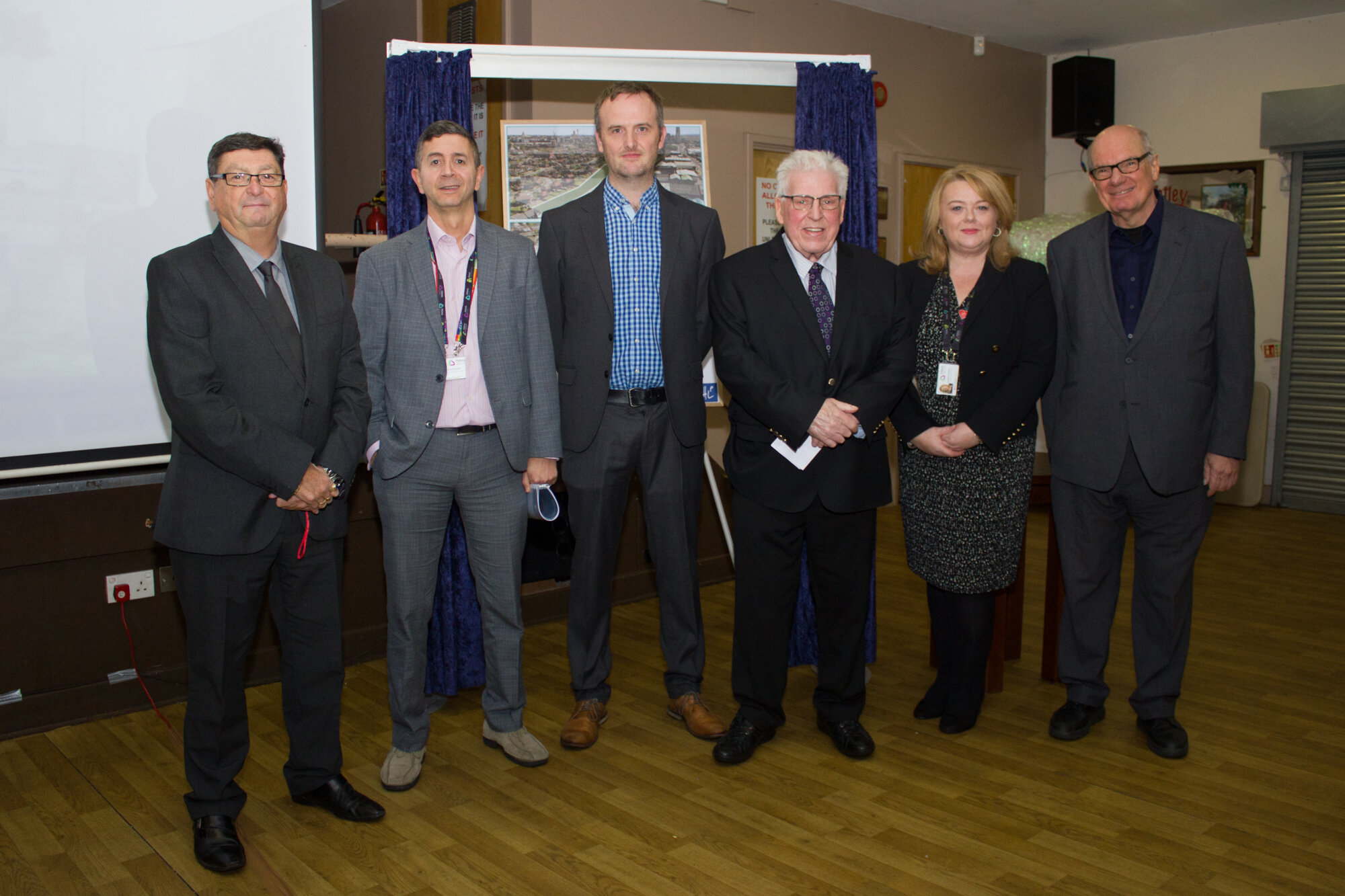 George Evans (CEO of the Eldonians), John Ghader (CEO of Prima Group), Craig Bradley (Specialist in Housing Delivery at Homes England), Tony McGann (Chairperson of the Eldonians), Angela Dodson (Development Manager at Prima Group) and Bill Halsall (Senior Partner at Halsall Lloyd Partnership)