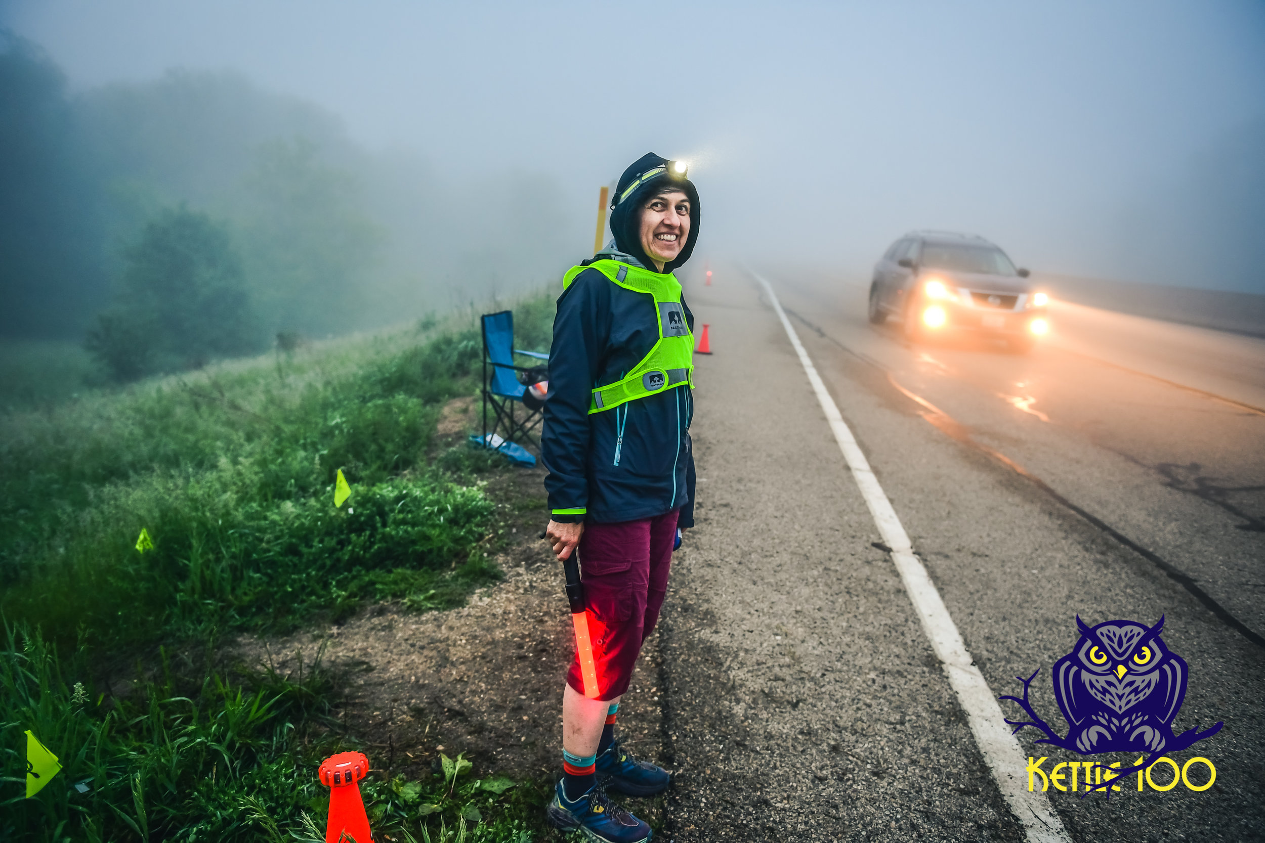 Becky Leahy helping runners cross Hwy 12 safely