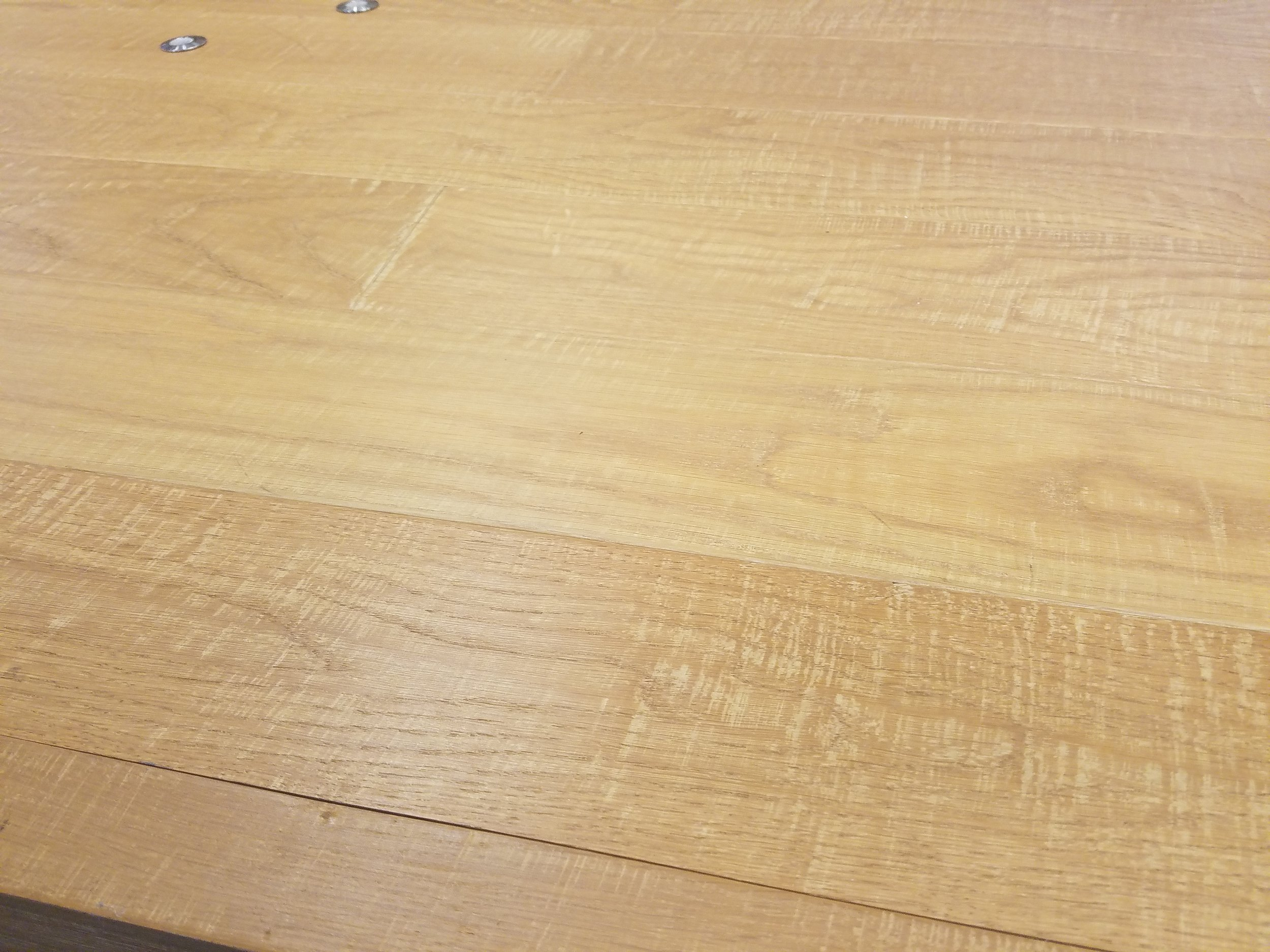 the flooring was hand-distressed and custom finished ot match the clients' design scheme