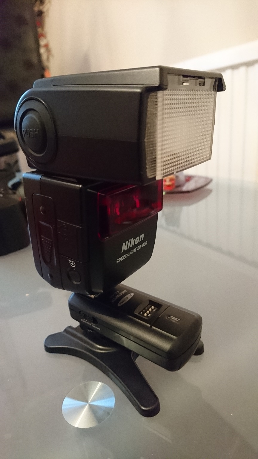 Neewer FC-16 receiver attached to flash and flash stand