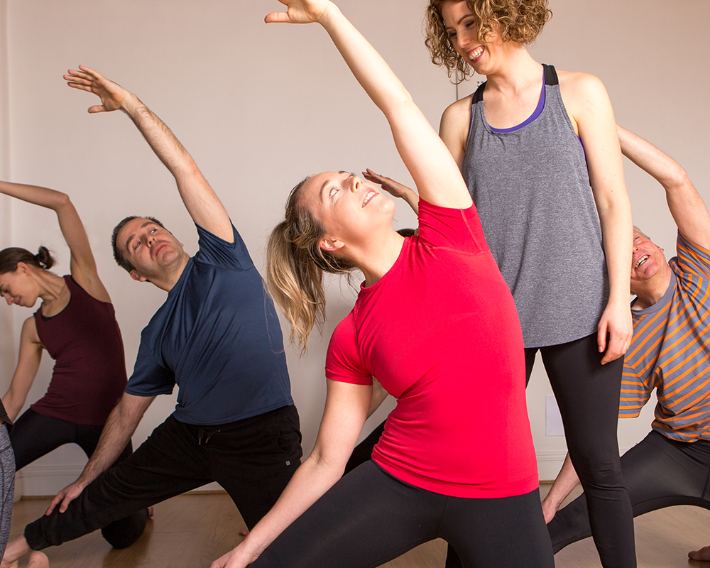 Janine teaches students gate pose
