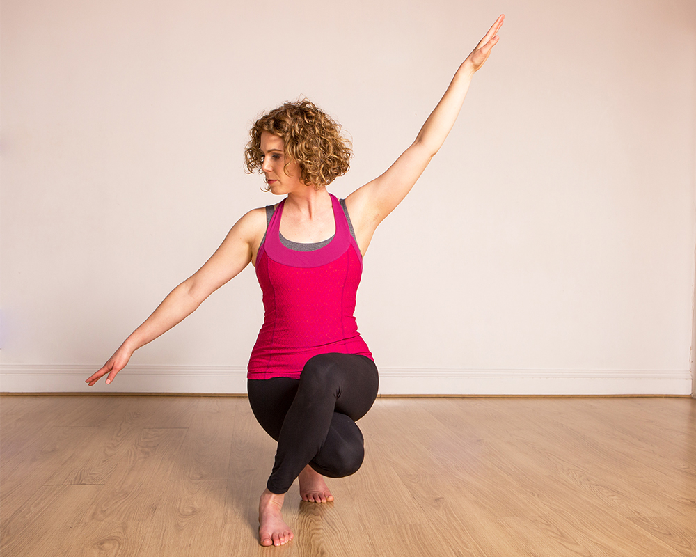 Janine practices a balancing yoga pose