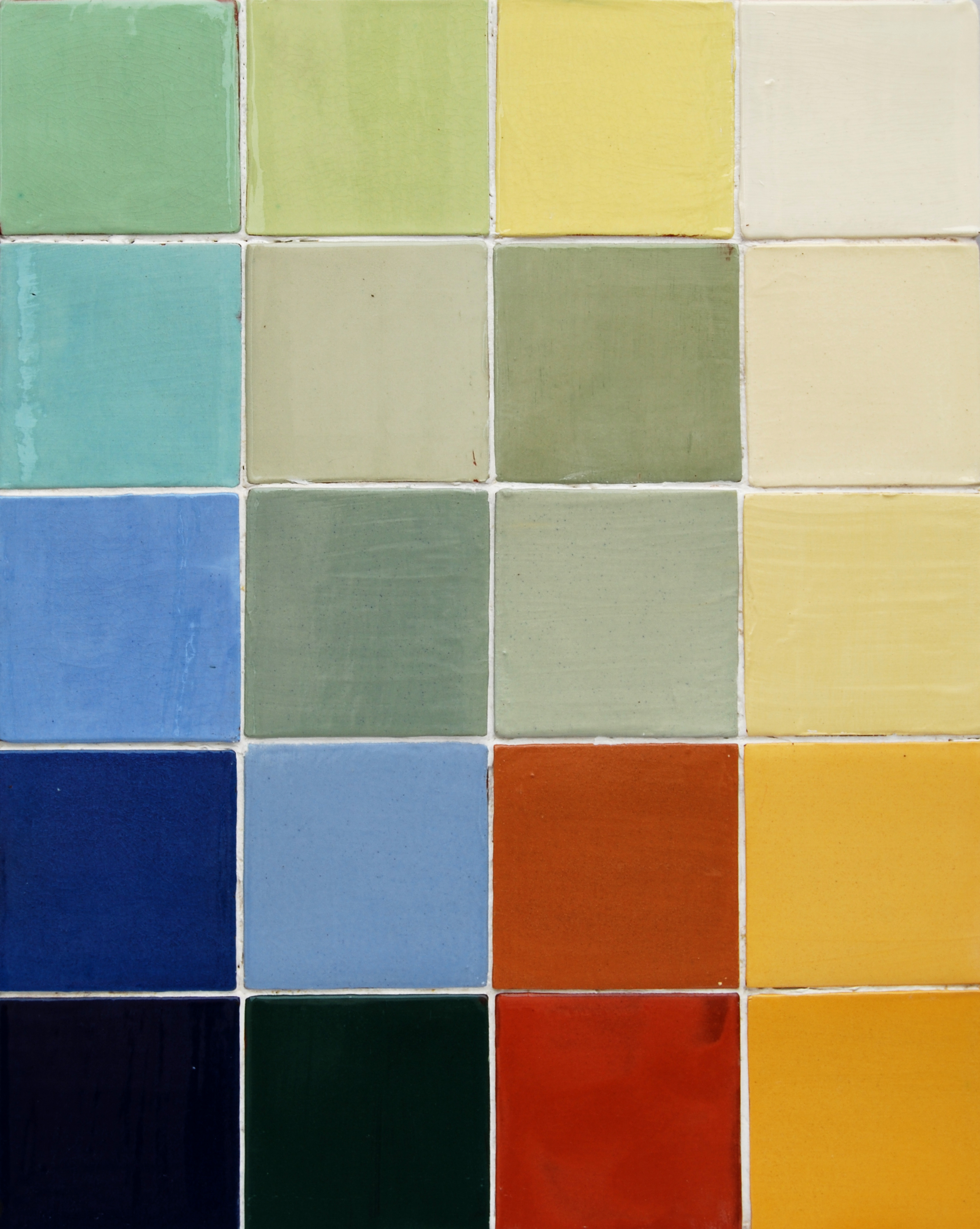 Plain Tiles - Our plain tiles can coordinate with the decors, or be used on their own. We have developed a range of unique, traditional clay-slip colours. Reading left to right:1st rowlagoon, apple, primrose, ivory 2nd rowazure, duck pond light, duck pond bright, cream.3rd rowmid blue, duck egg bright, duck egg light, primrose.4th rowindigo, delphinium, warm earth, light gold ochre.5th rowblack, spruce green, autumn red, dark ochre.