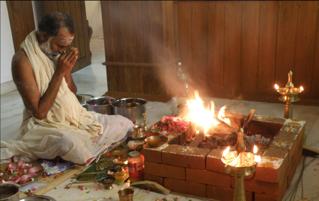 My Guru performing a fire ceremony