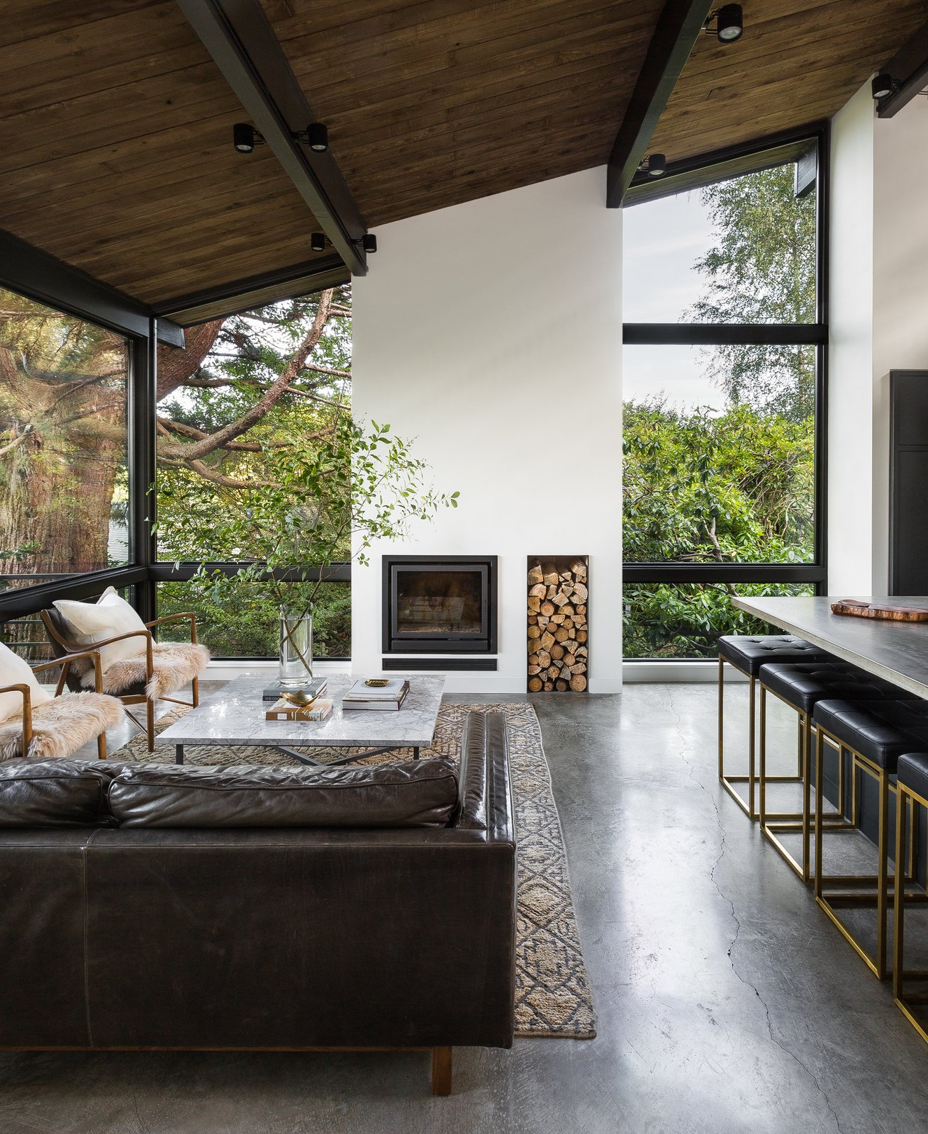 a-new-double-height-fireplace-column-is-the-focal-point-of-the-new-living-room-and-underscores-the-rooms-graceful-proportions