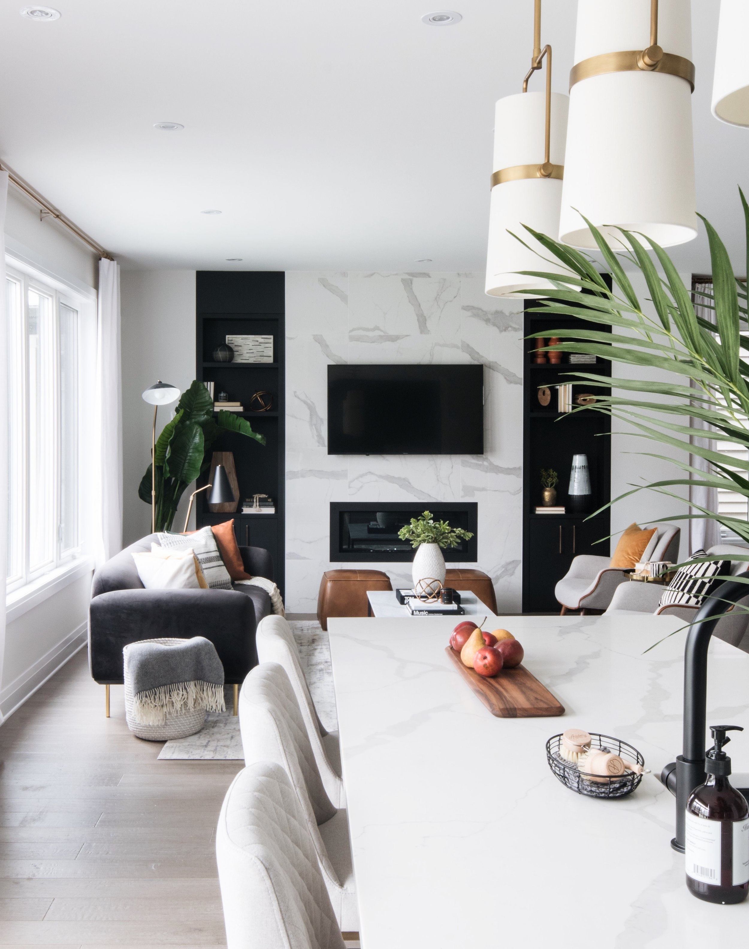 A home that feels sleek and cool, but still approachable by Ottawa Interior Design firm Leclair Decor. The perfect embodiment of their signature warm modern aesthetic.