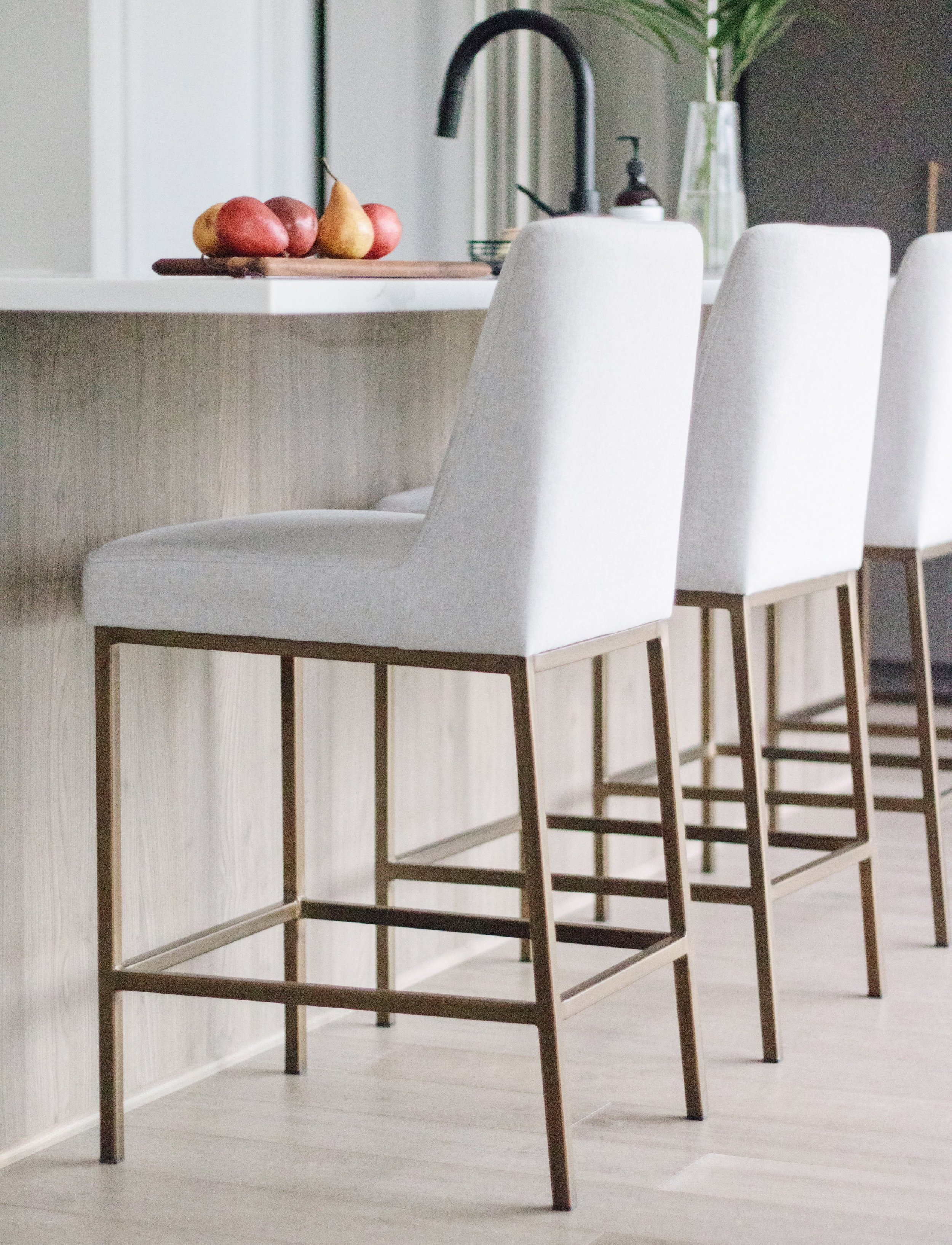 Modern but inviting counter stools sit pretty at Ottawa based interior design firm Leclair Decor's Cedarbreeze project.