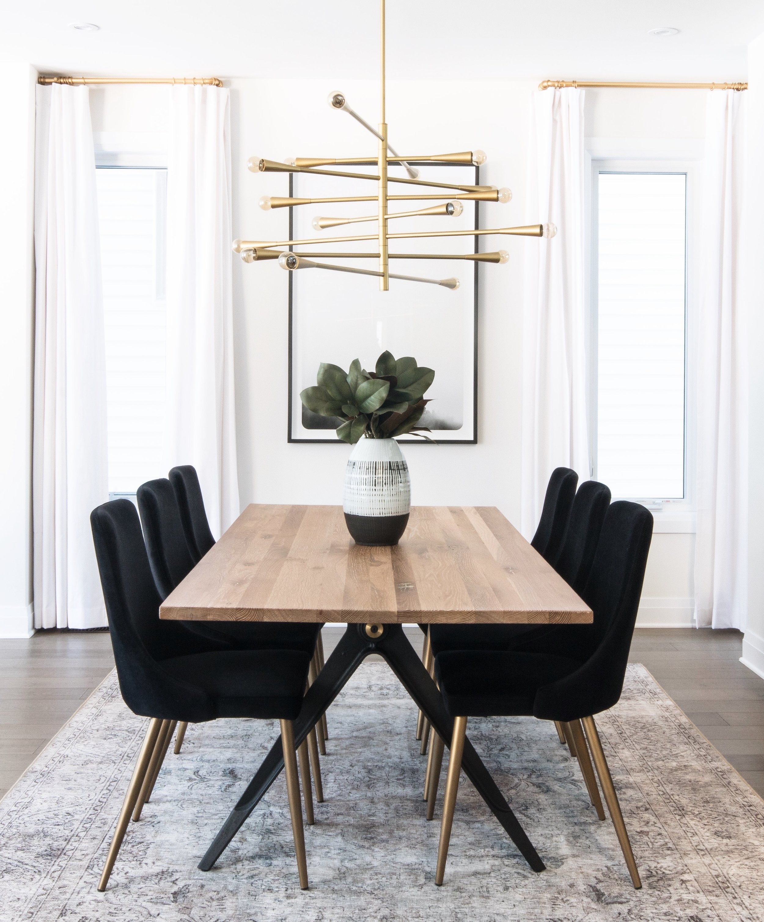 Modern and inviting formal dining space by Ottawa interior design firm Leclair Decor.