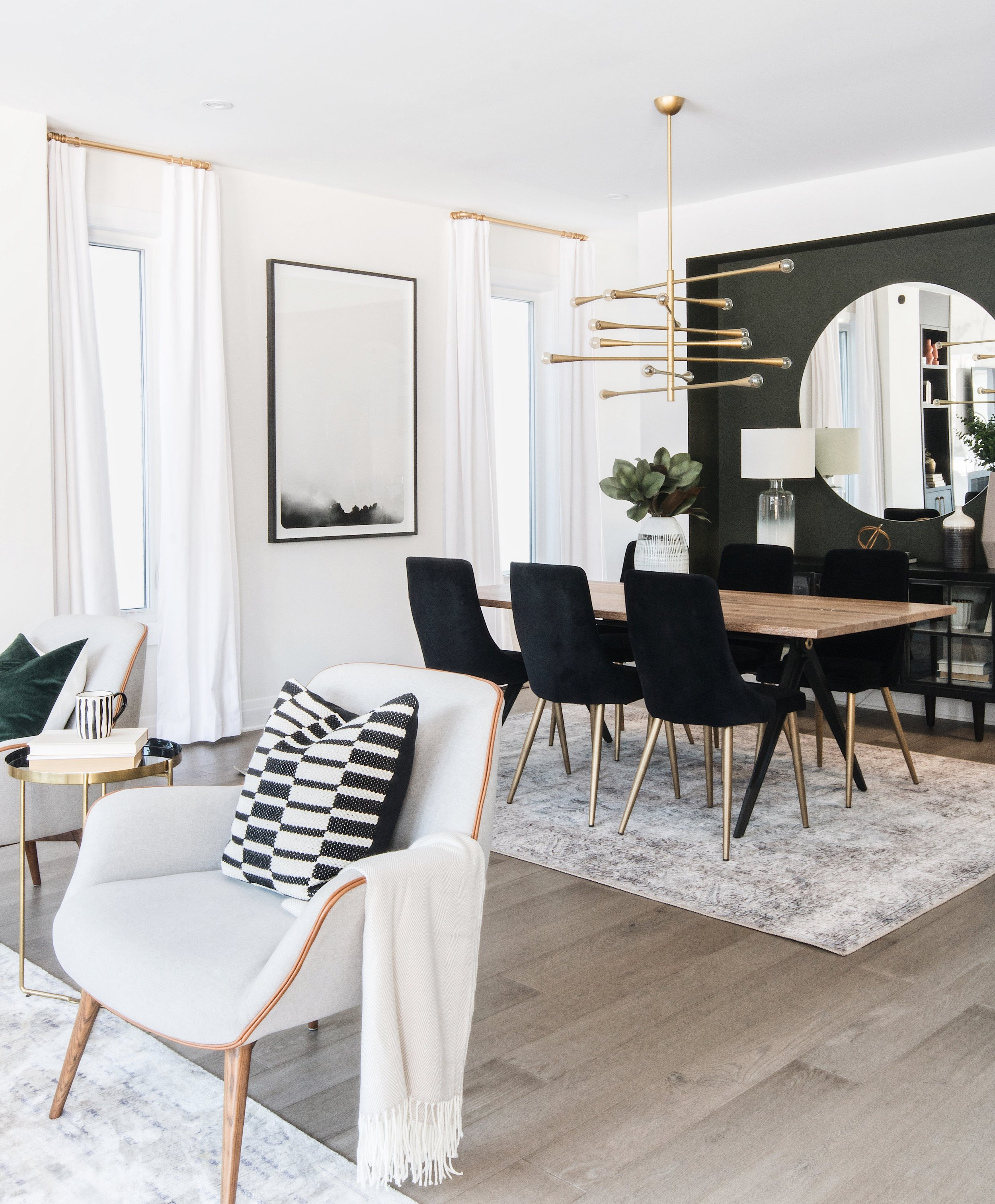 Modern but cozy living room and dining room design by Ottawa based interior design firm, Leclair Decor.