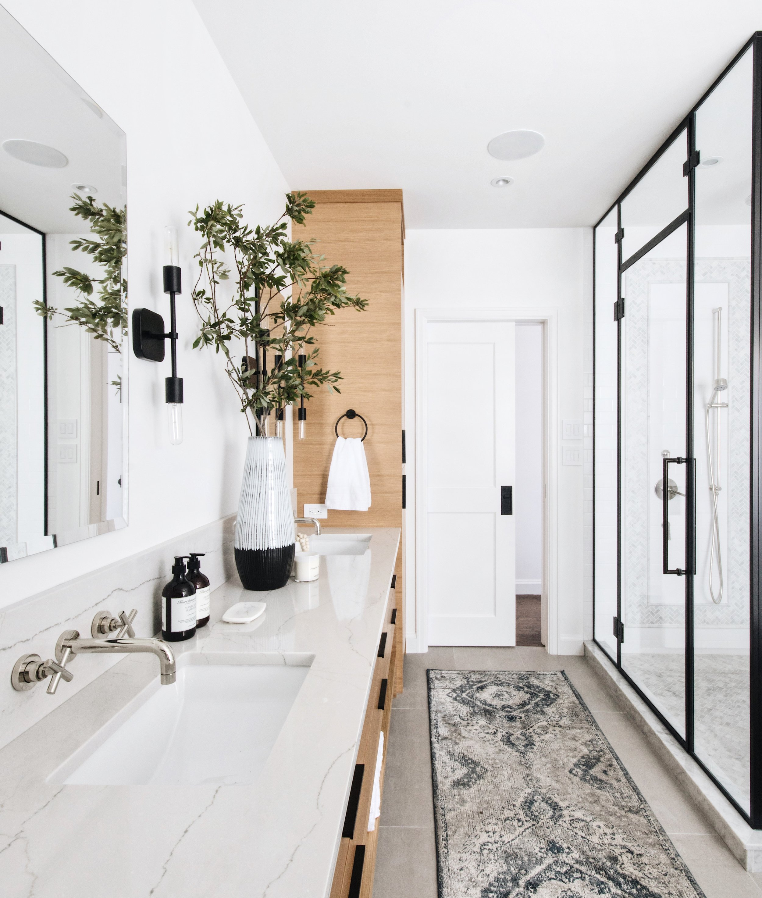 How-to style a powder room or master ensuite. Natural Wood Tones in Master Ensuite Bedroom by Ottawa Interior Design Firm Leclair Decor