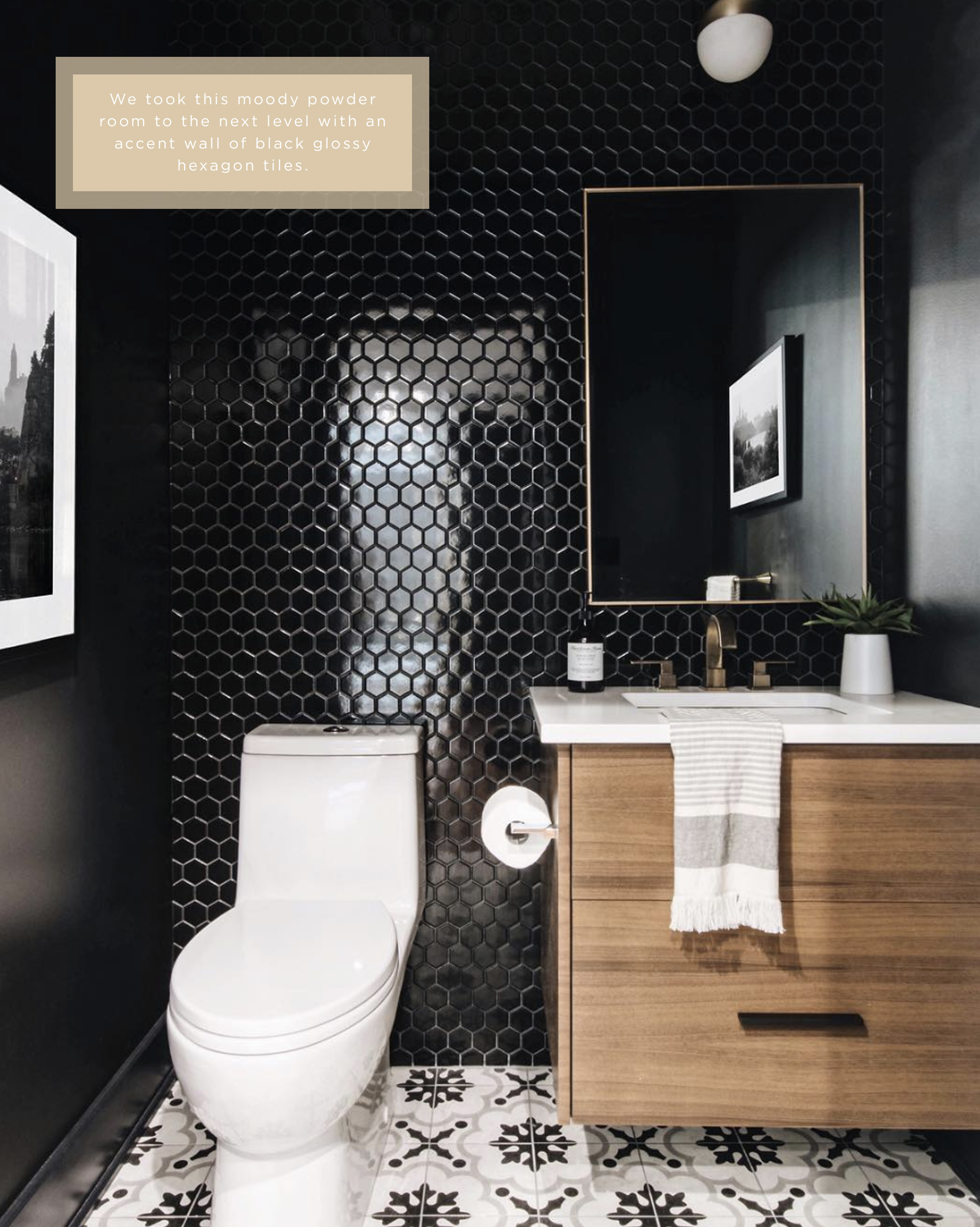 Statement powder room with accent wall of glossy black hexagon tiles by Ottawa Interior Design Firm Leclair Decor