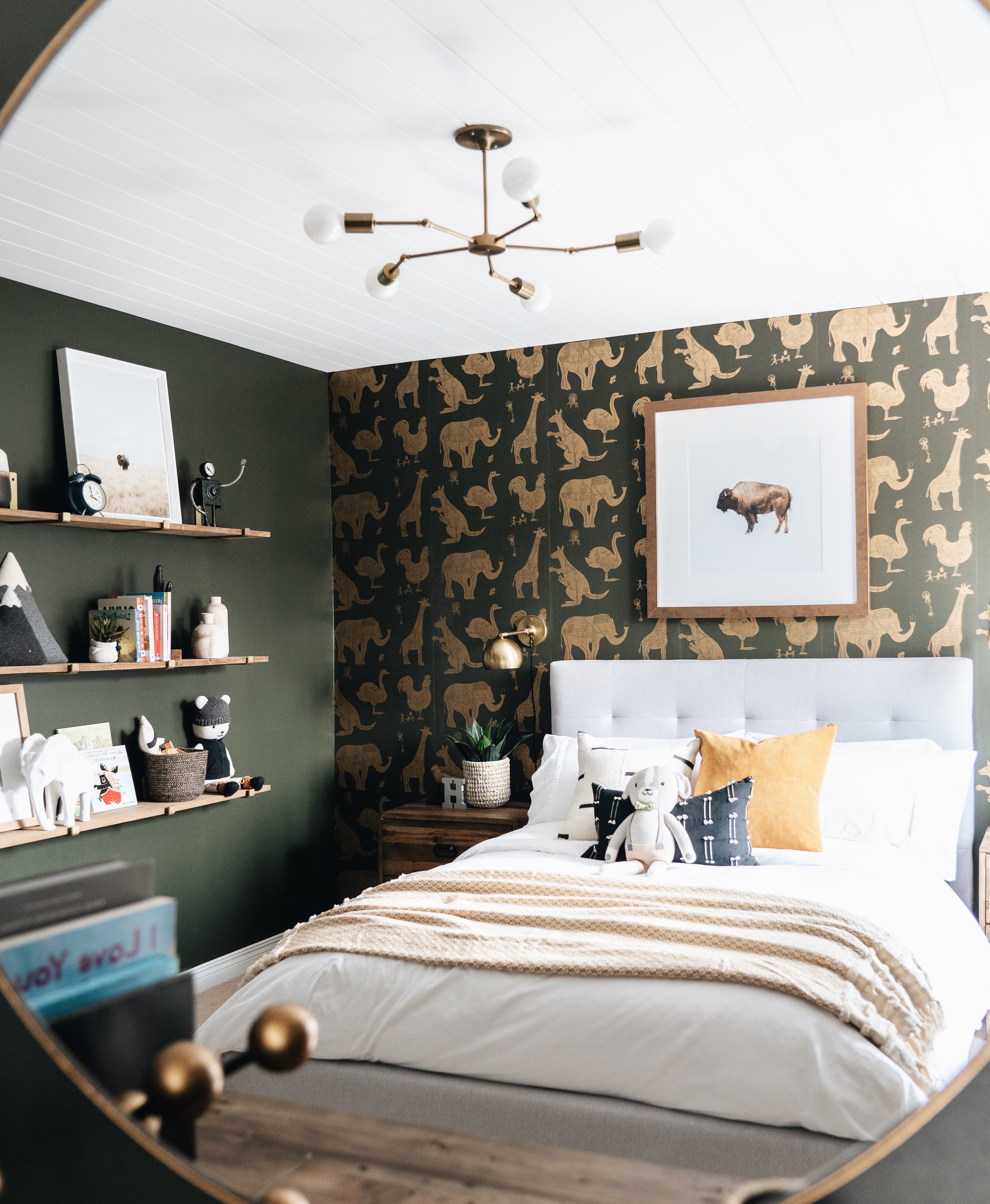 Moody and modern with a with a hint of rustic charm in this beautiful, playful  little boy's bedroom by Ottawa design firm Leclair Decor.