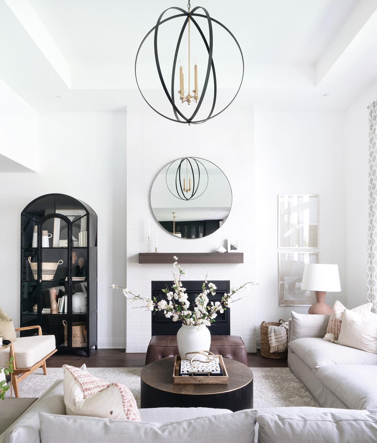 Shop the living room |   Haven Sectional  ,   Waltham Mirror  ,   Errant Orb Pendant  ,   Perry Coffee Table  ,   Lily Cabinet