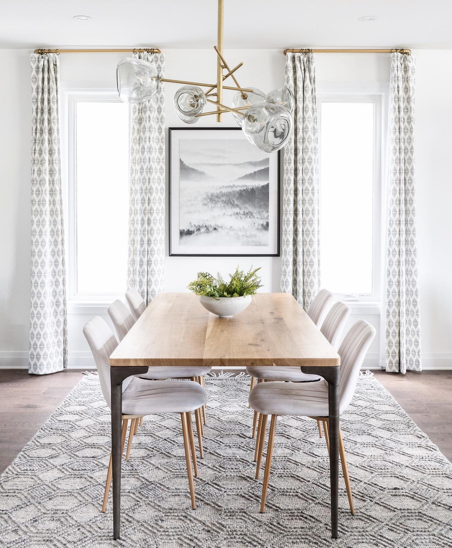 Shop the dining room |   Peter Dining Table  ,   Milton Chandelier  ,   Layered Mountain Fog 1 Framed Print  ,     Holloway Grey Rug