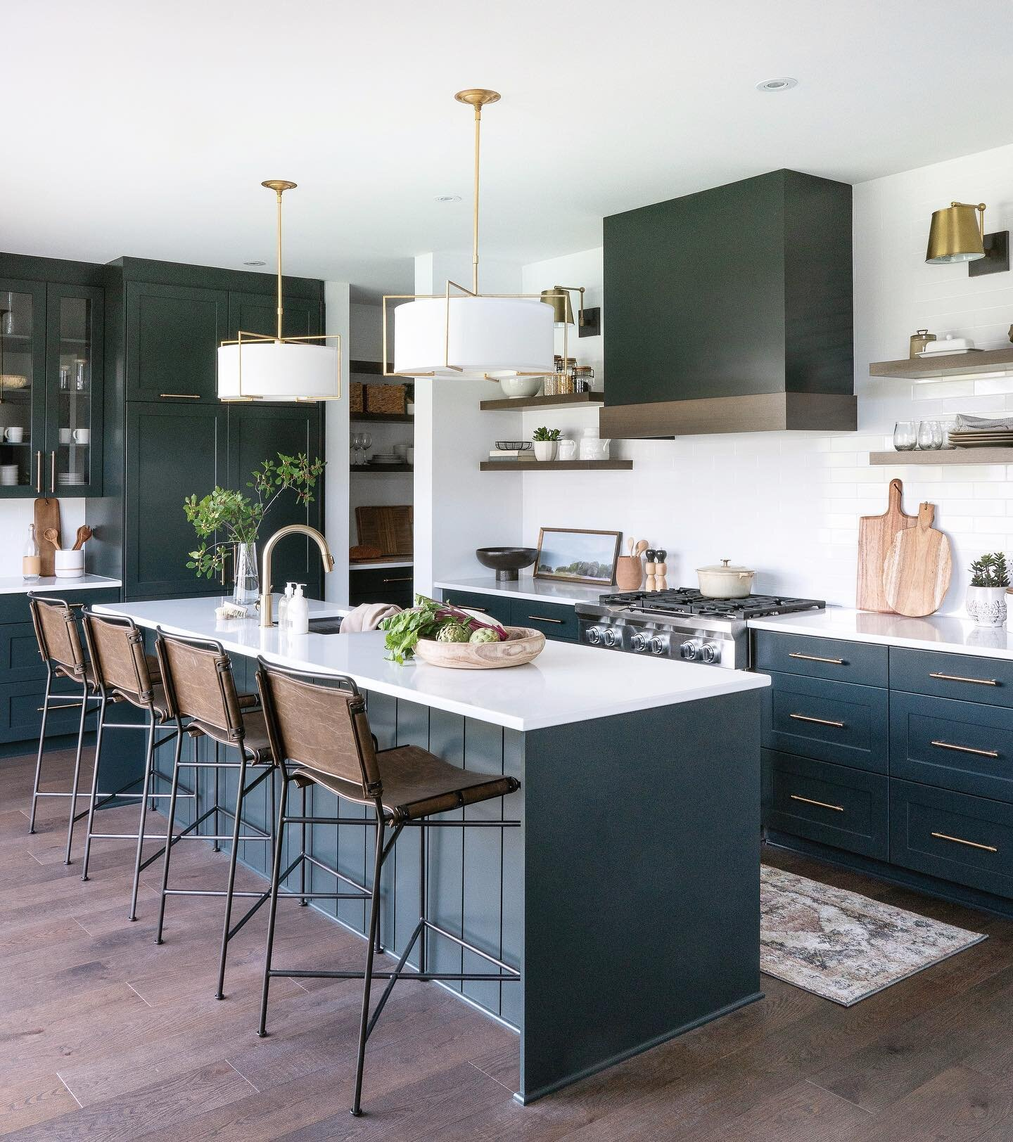 Shop the kitchen |   Liam Pendants  ,   Wharton Counter Stool  ,   Watson Sconces