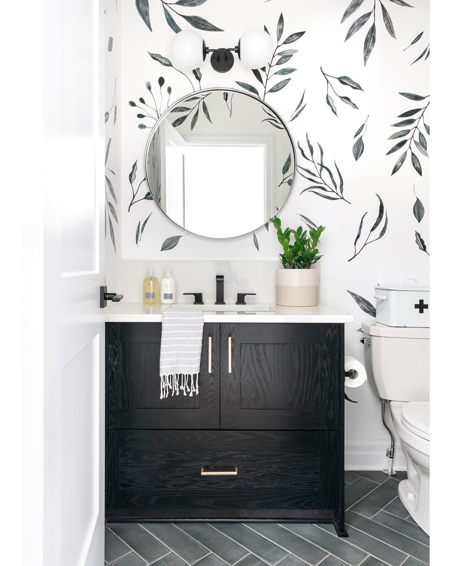 Botanical decals were all that was needed to elevate this simple bathroom.
