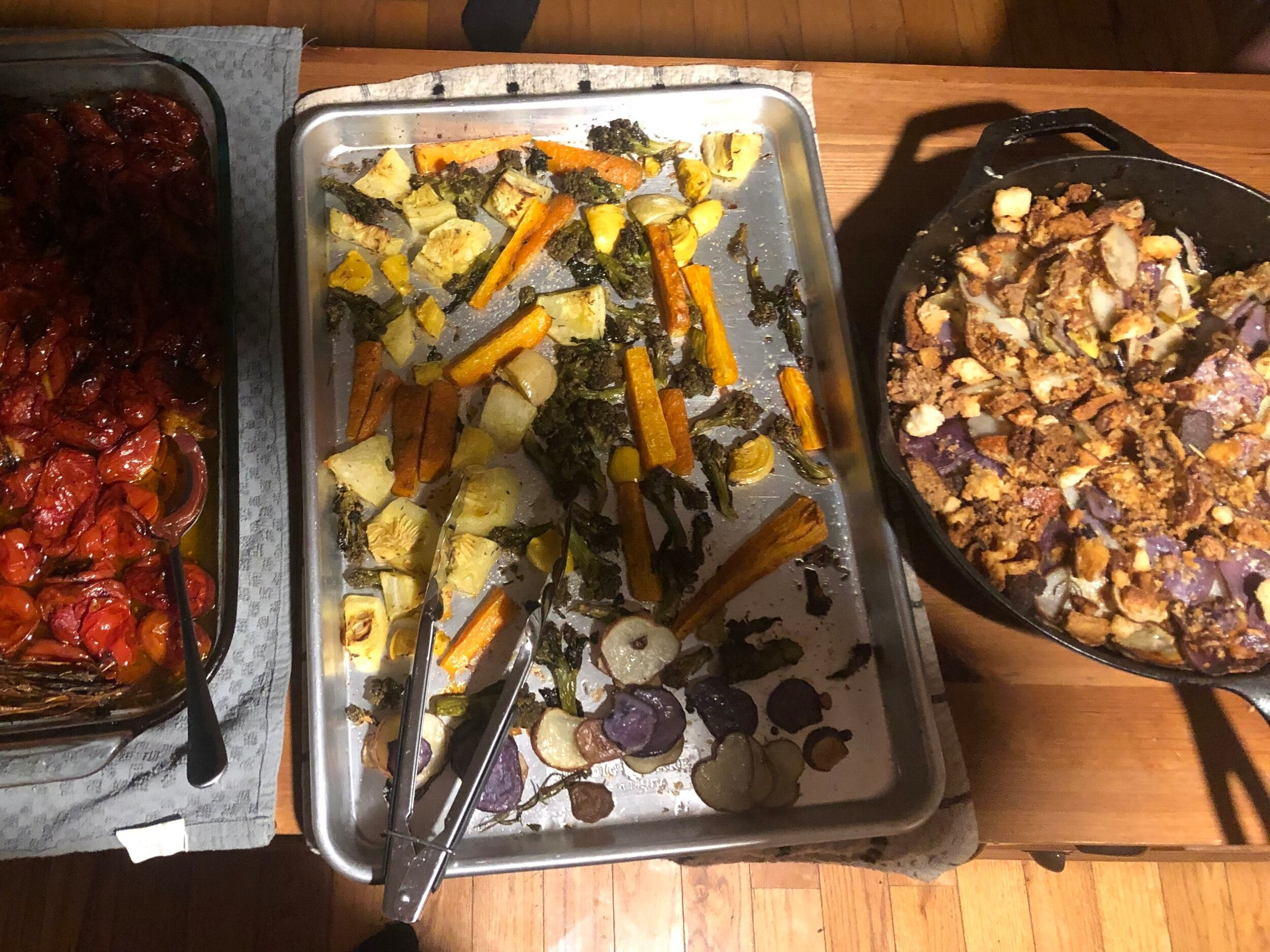 Here is a bad quality picture of dinner: olive oil slow roasted tomatoes; all of the rotting vegetables in the vegetable drawer (squash, carrots, cauliflower, potatoes) covered in salt, olive oil, garlic powder, and herbs de provence; squash and potato gratin roasted in the bacon drippings from our camping trip and covered in garlic bread crumbs.