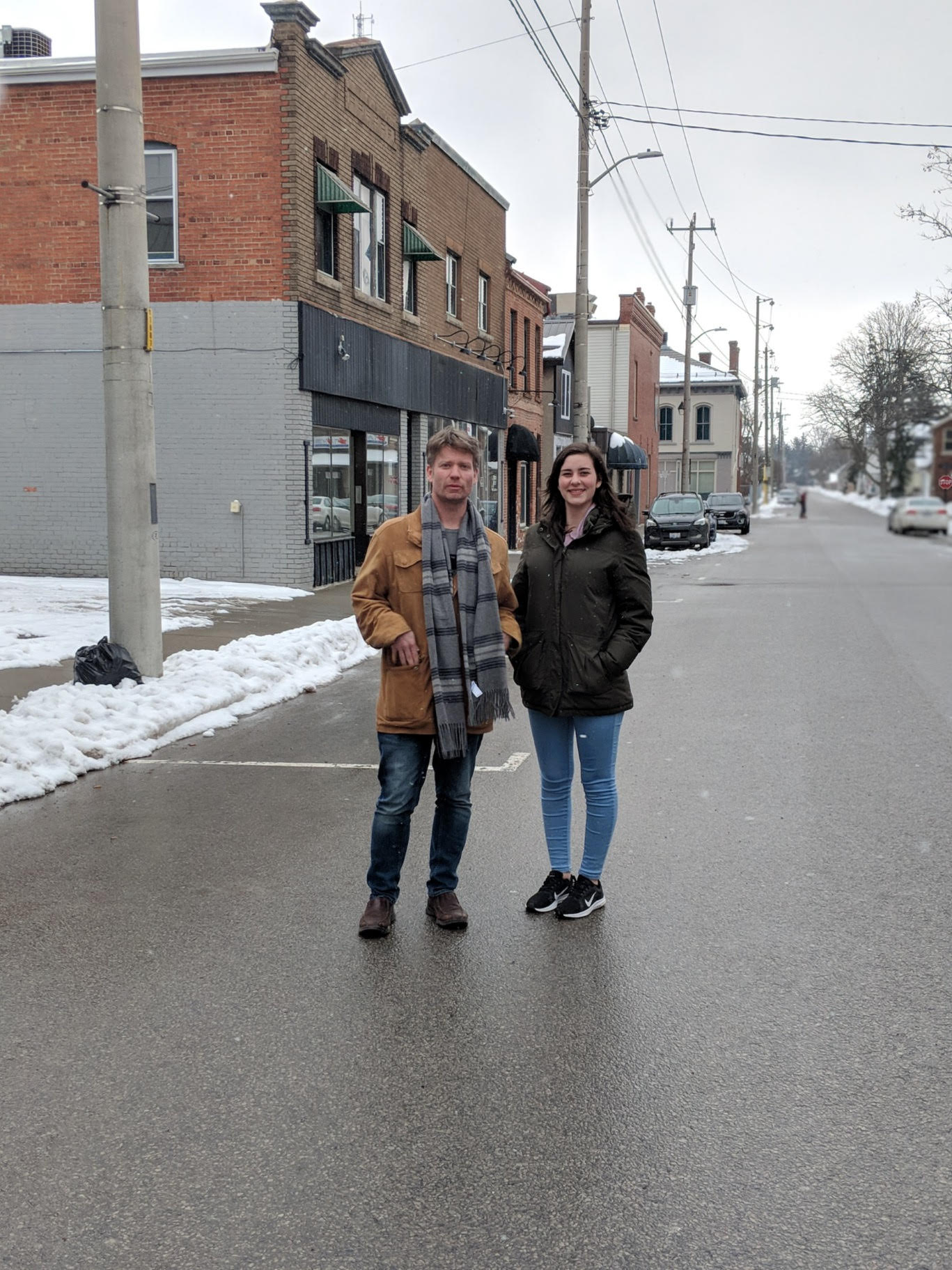 In the first photo, Jenn and Maddie stand on Dundas Place in London around the holidays, just after the flex-street opened up following construction. Notice the absence of curbs. In the second photo, Andrew and Emily stand on Kent Street in Simcoe. Perhaps this area in downtown Simcoe could be transformed into a flex-street, too.