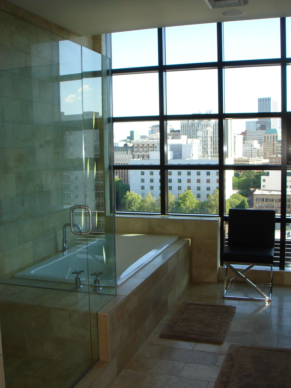 Modern bathroom with bathtub and a city view